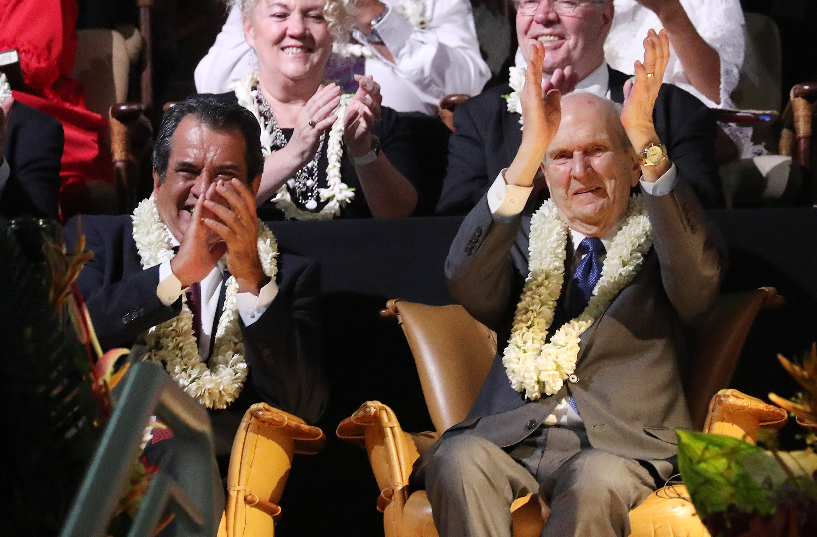 President Russell M. Nelson of The Church of Jesus Christ of Latter-day Saints, right, and French Polynesia President Edouard Fritch applaud performers during a Tahiti cultural program in Papeete, Tahiti, on May 24, 2019.