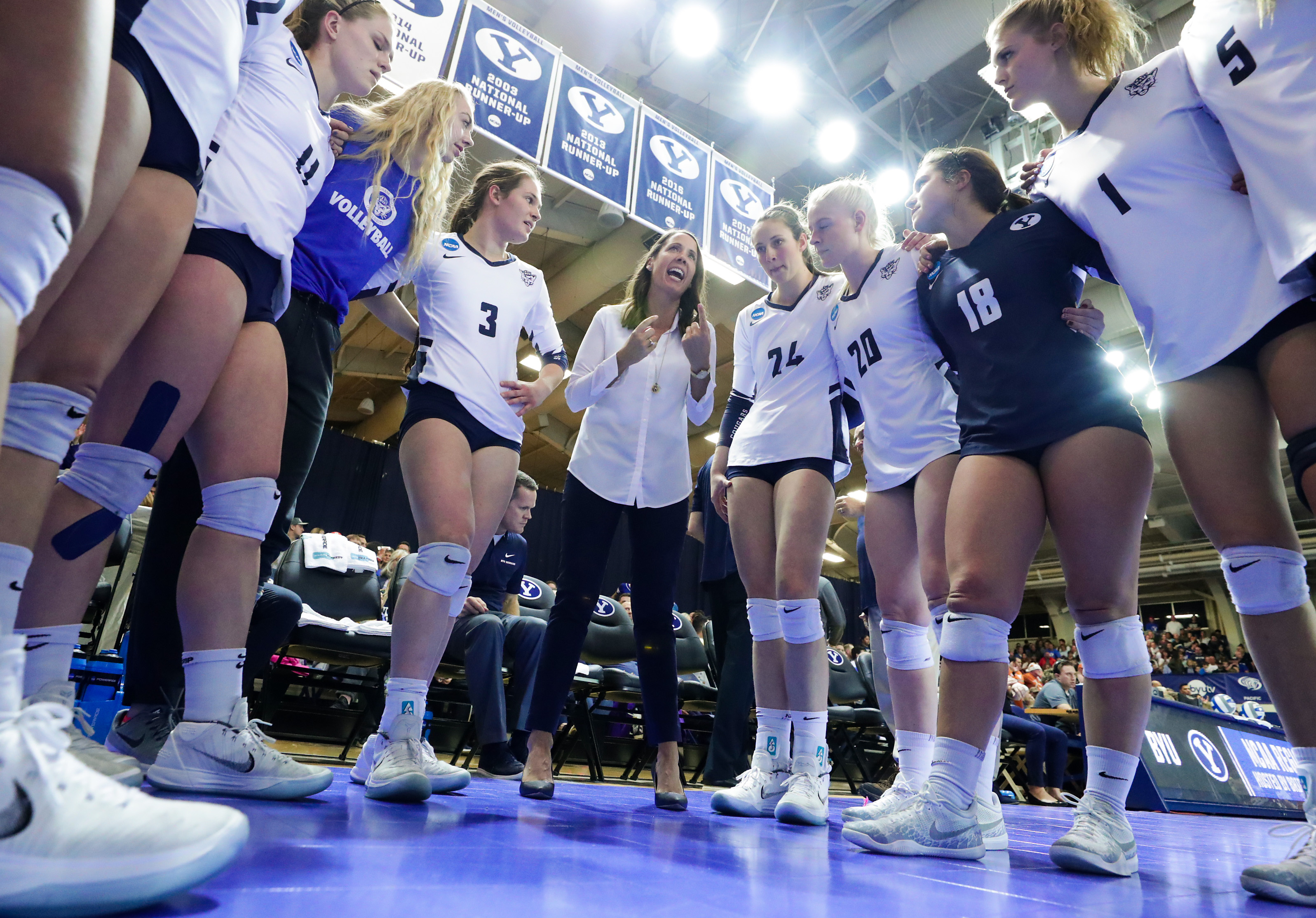 JW1_8537 BYU Head Coach Heather Olmstead talks to her team before the match. The #4 BYU Women's Volleyball team defeated #5 Texas 3-0 in the Regional Final of the NCAA Women's Volleyball Championships. 18wVLB NCAA vs Texas #4 BYU defeats #5 Texas 3-0 December 8, 2018 Photo by Jaren Wilkey/BYU BYU PHOTO 2018 All Rights Reserved photo@byu.edu (801)422-7322
