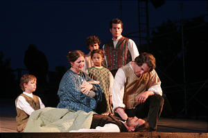 In scene from new Nauvoo pageant, Joseph Smith consoles Elijah Fordam and his family, prior to Joseph and brother Hyrum, rear, laying their hands on Elijah to heal him.
