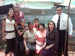 Sister Silvia H. Allred, first counselor in the Relief Society general presidency, seated in center, with Elder Rafael E. Pino of the Seventy, right, and his wife, Patricia, seated right, visit the Gonzales family in Venezuela. Members in these South America countries remain strong in the gospel by holding regular family home evening and Church attendance. The Gonzales family also sings together in the ward choir.