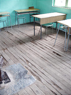 An example of the deteriorated floors in the Zahir school in Turiqca, Kosovo.