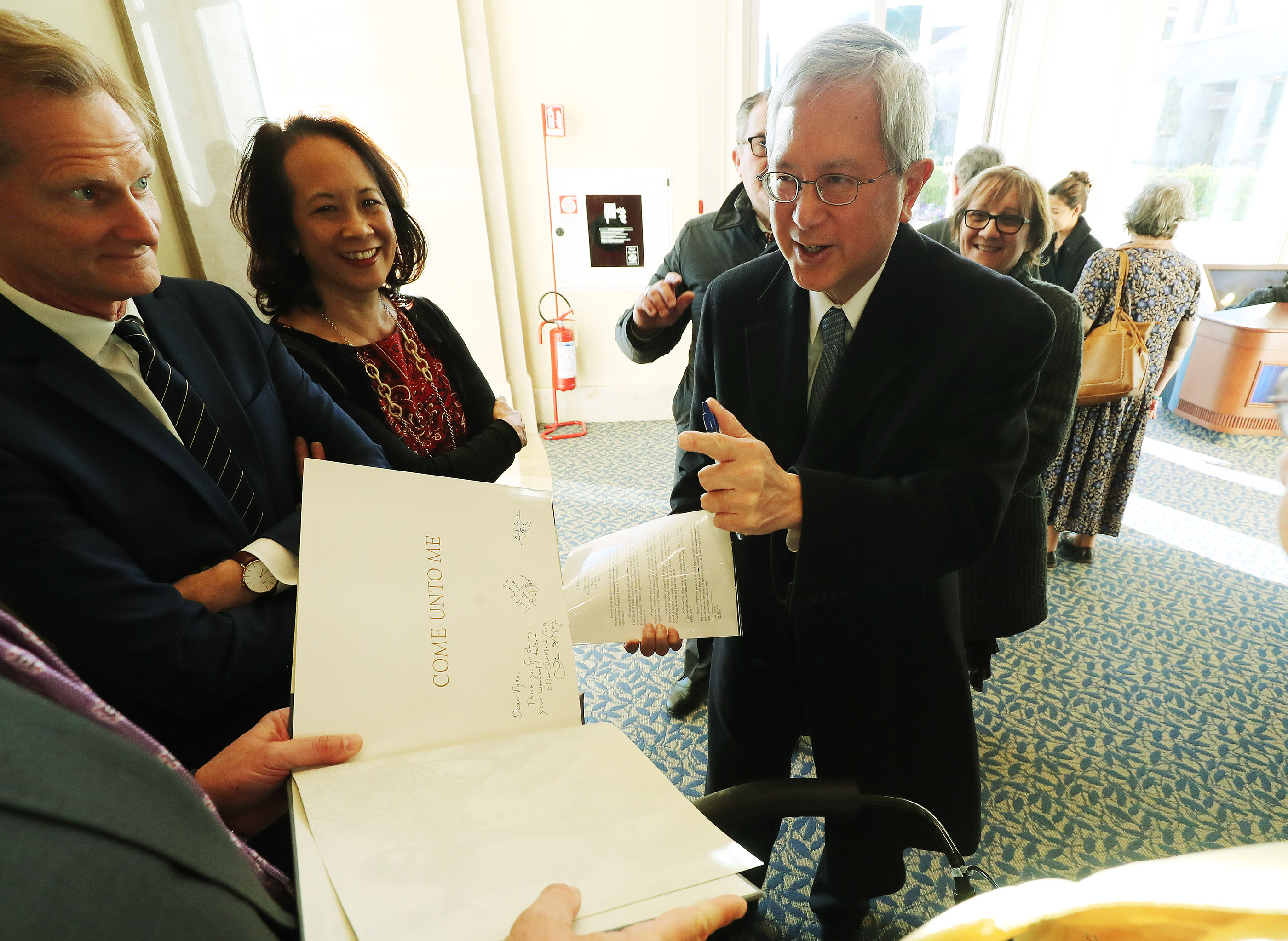 Elder Gerrit W. Gong of the Quorum of the Twelve Apostles of The Church of Jesus Christ of Latter-day Saints, signs a book in Rome on Tuesday, March 12, 2019.
