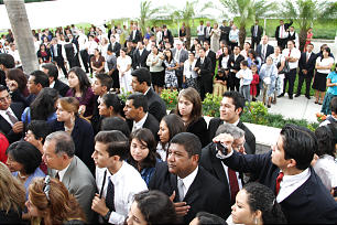 Crowds gather outside the El Salvador temple to listen to President Henry B. Eyring during the cornerstone ceremony. Thousands were able to attend one of the three dedicatory sessions. Many more viewed the ceremonies through a closed circuit broadcast.