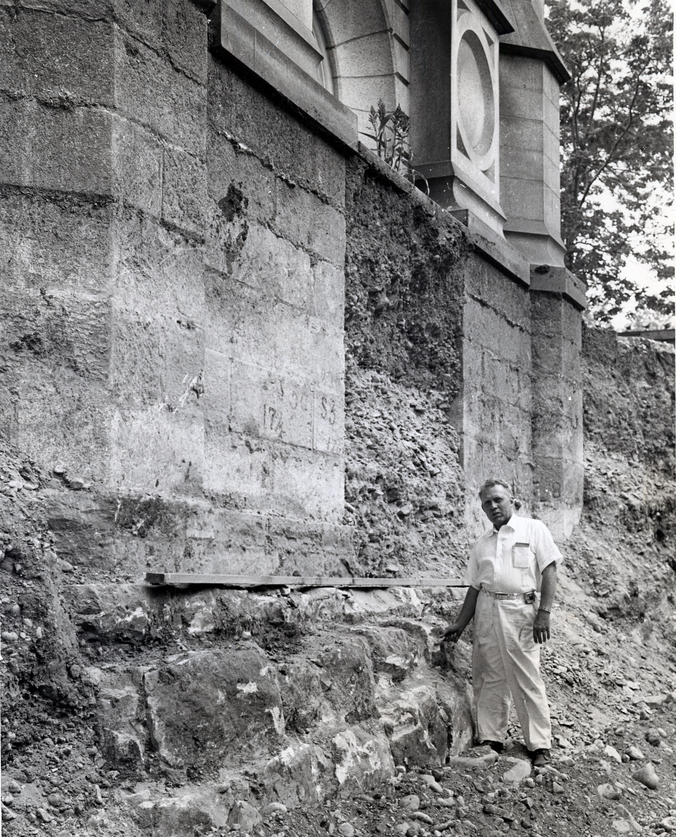 Linden W. Millgate, engineer, inspects the footings of the Salt Lake Temple while its massive foundation was exposed during work on Sept. 8, 1962.