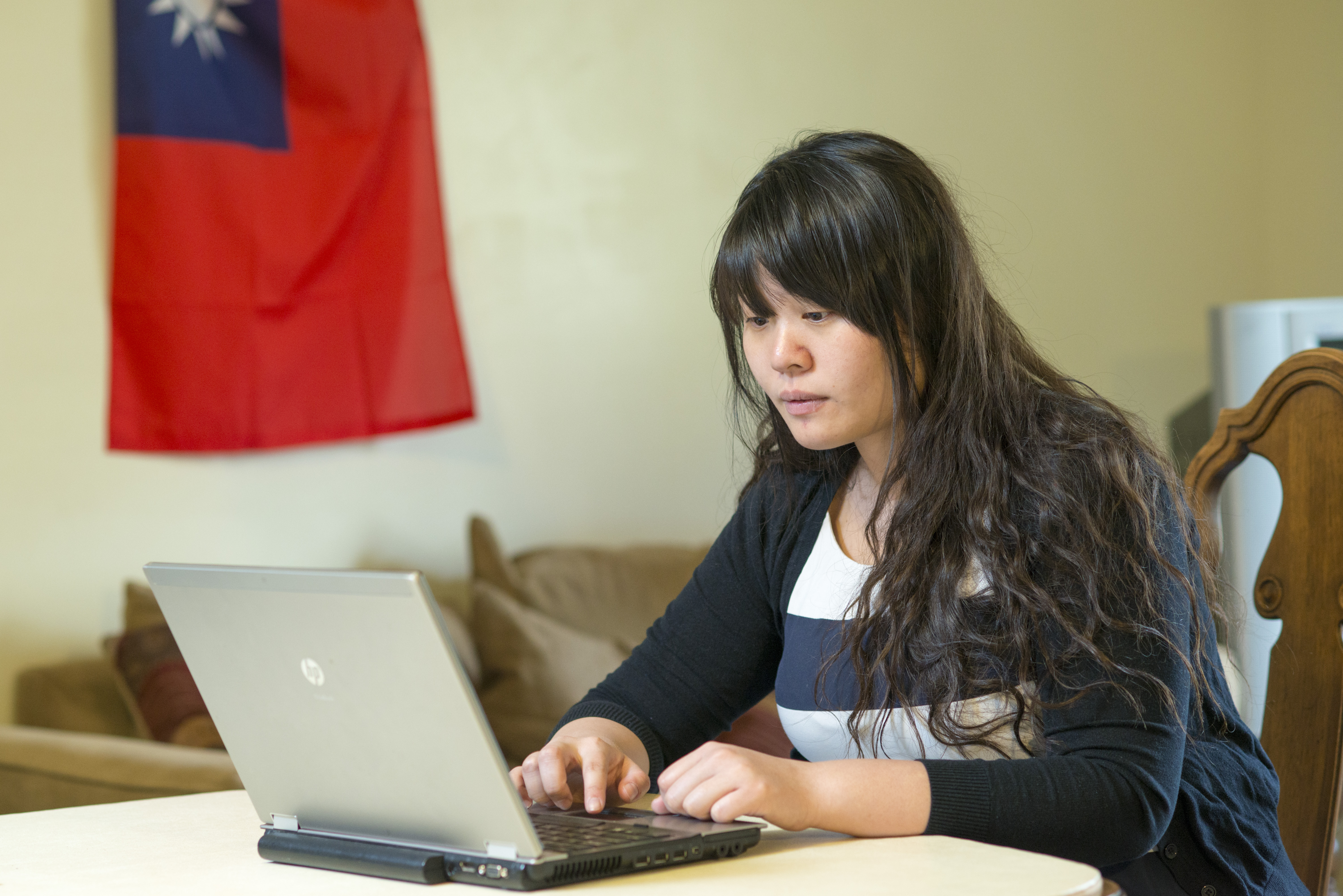 Pathway student, Chia Hsin, studies at her home in April 2017.
