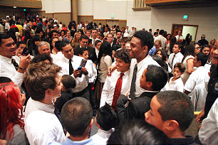 "Jabari Parker visits with other youth after he spoke at a devotional for the Oakland California East Stake. The 17-year-old Latter-day Saint is the country's No. 1 high school basketball player who champions good values and living the gospel. ""We will all have opportunities to teach the gospel and to be a good example. It can happen anytime, anyplace,"" he said."