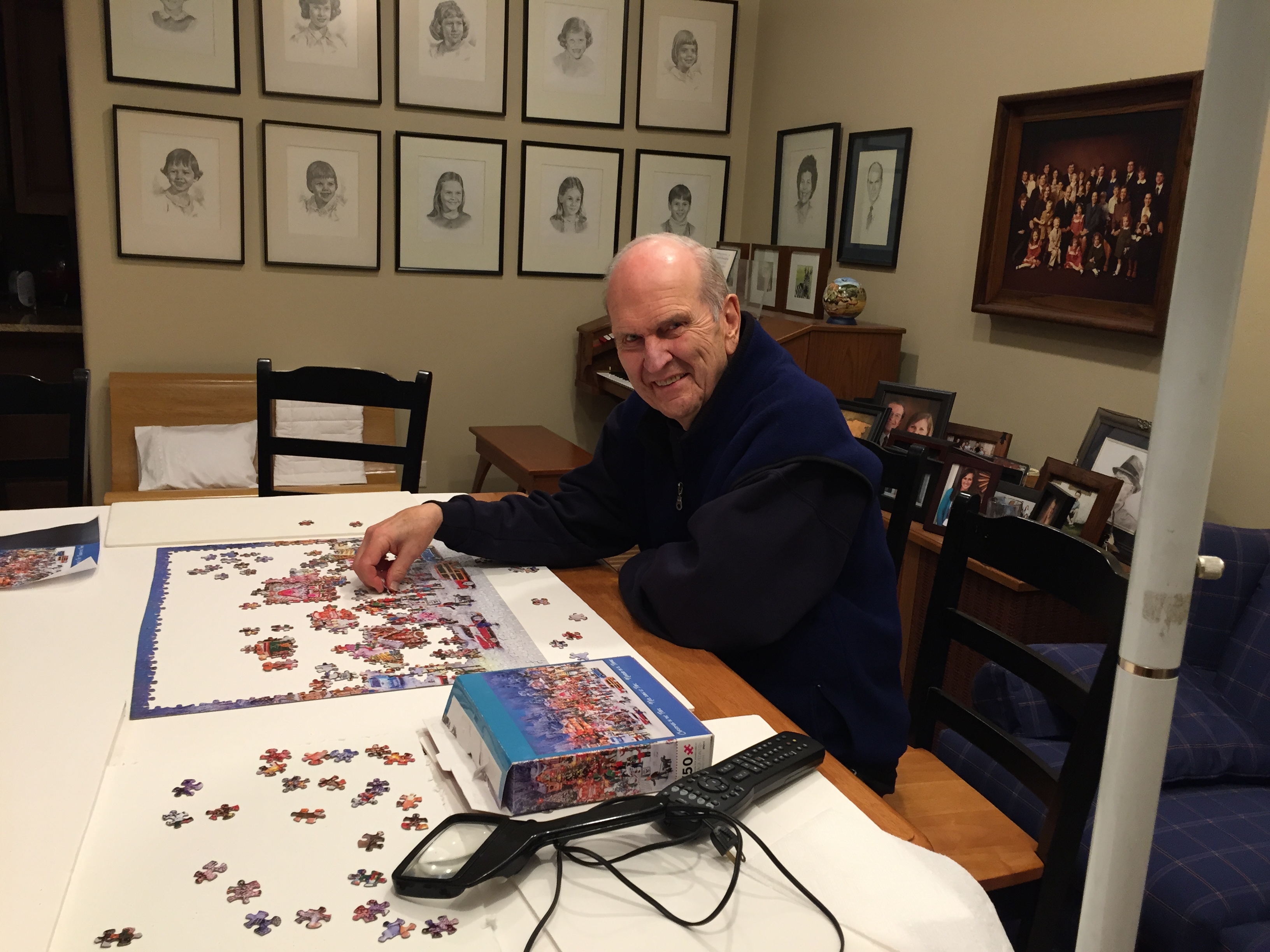 President Russell M. Nelson sits down with a puzzle in his spare time.