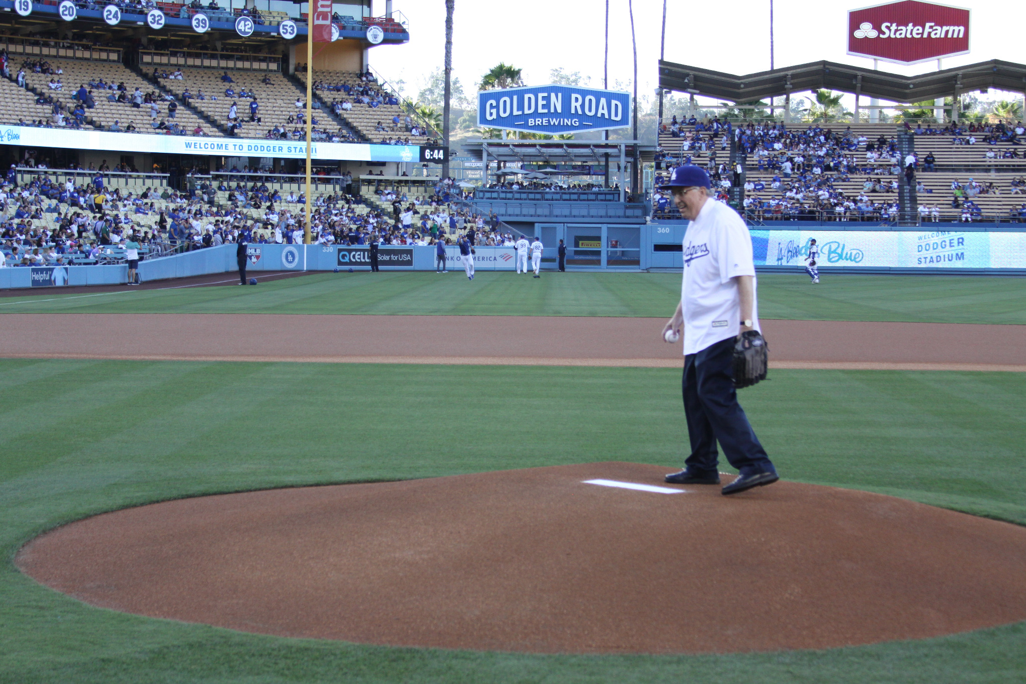 Elder Neil L. Andersen throws the first pitch as the Los Angeles Dodgers take on the Miami Marlins at Dodger Stadium on July 19, 2019.