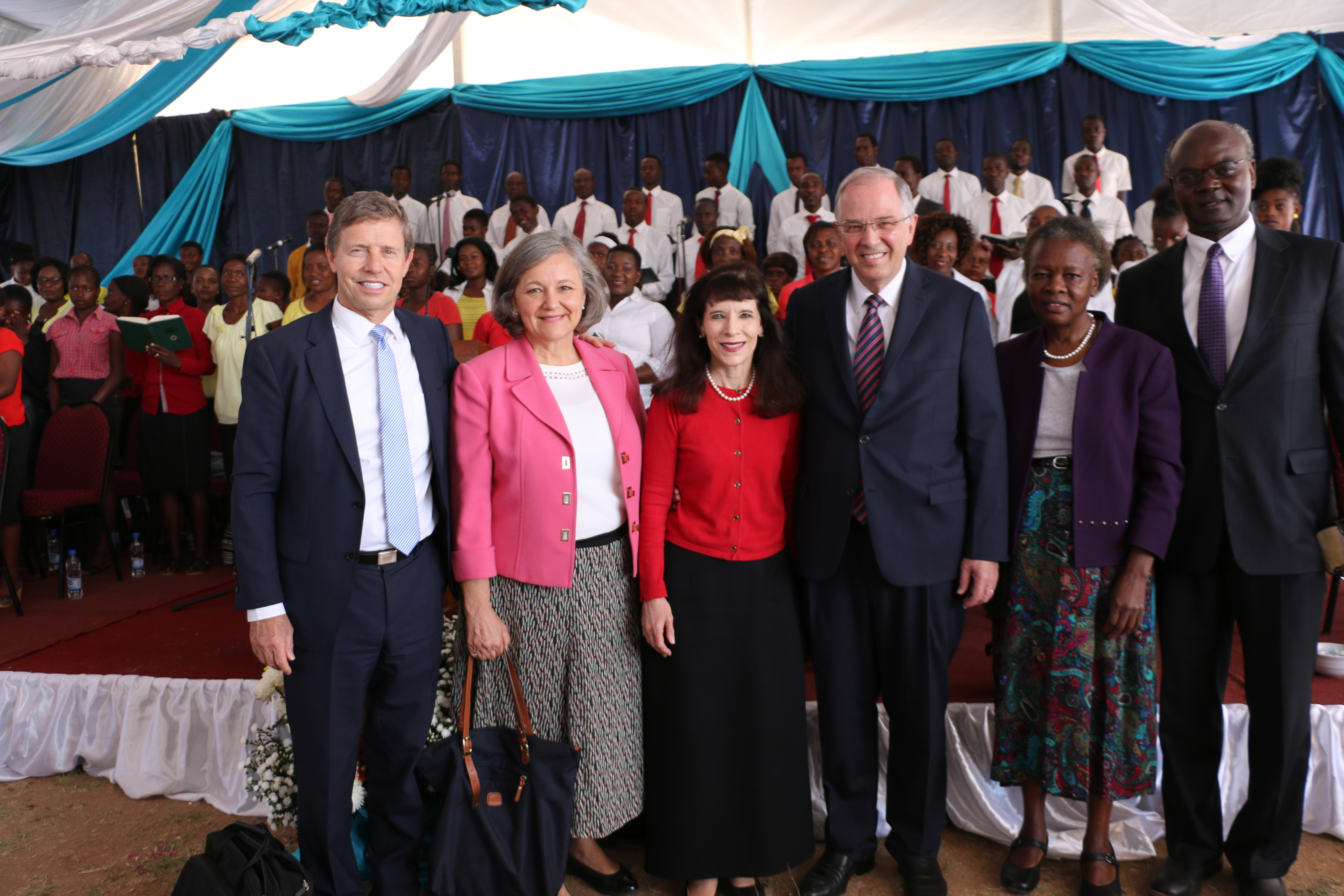 Elder Neil L. Andersen of the Quorum of the Twelve Apostles, center with Sister Kathy Andersen; Elder S. Mark Palmer, a General Authority Seventy, and Sister Jacqueline W. Palmer, left; and Elder Jospeh W. Sitati, a General Authority Seventy, and Sister Gladys N. Sitati stand together after a member meeting in Zimbabwe on Nov. 18. 2018.