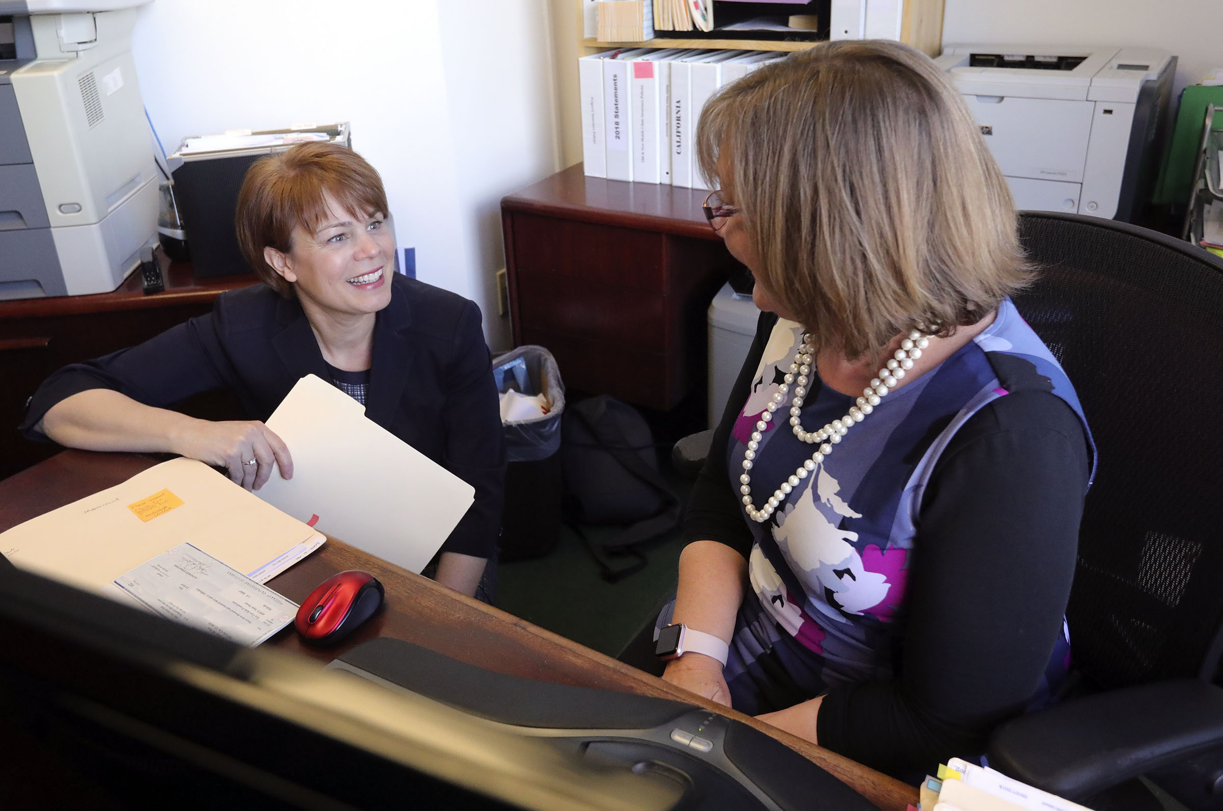 Sister Sharon Eubank, first counselor in the Relief Society general presidency of The Church of Jesus Christ of Latter-day Saints, chats with Eye Care 4 Kids bookkeeper Christie Allred at Eye Care 4 Kids in Midvale, Utah, on Thursday, Feb. 7, 2019. The Church of Jesus Christ of Latter-day Saints 2018 Light the World campaign raised more than $93,000 for Eye Care 4 Kids.
