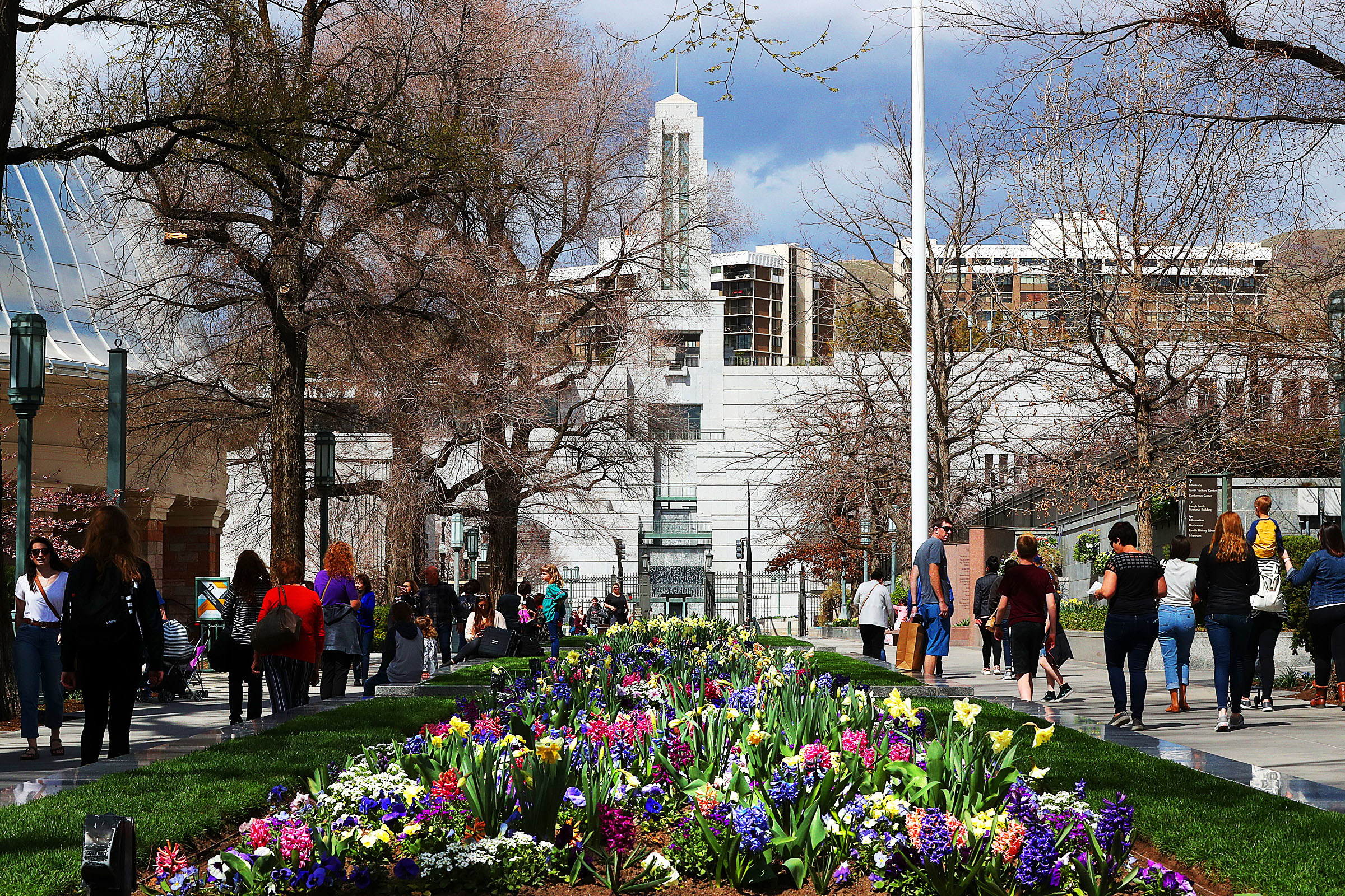 Flowers bloom on Temple Square of The Church of Jesus Christ of Latter-day Saints in Salt Lake City on Friday, April 5, 2019. In the background is the Conference Center.