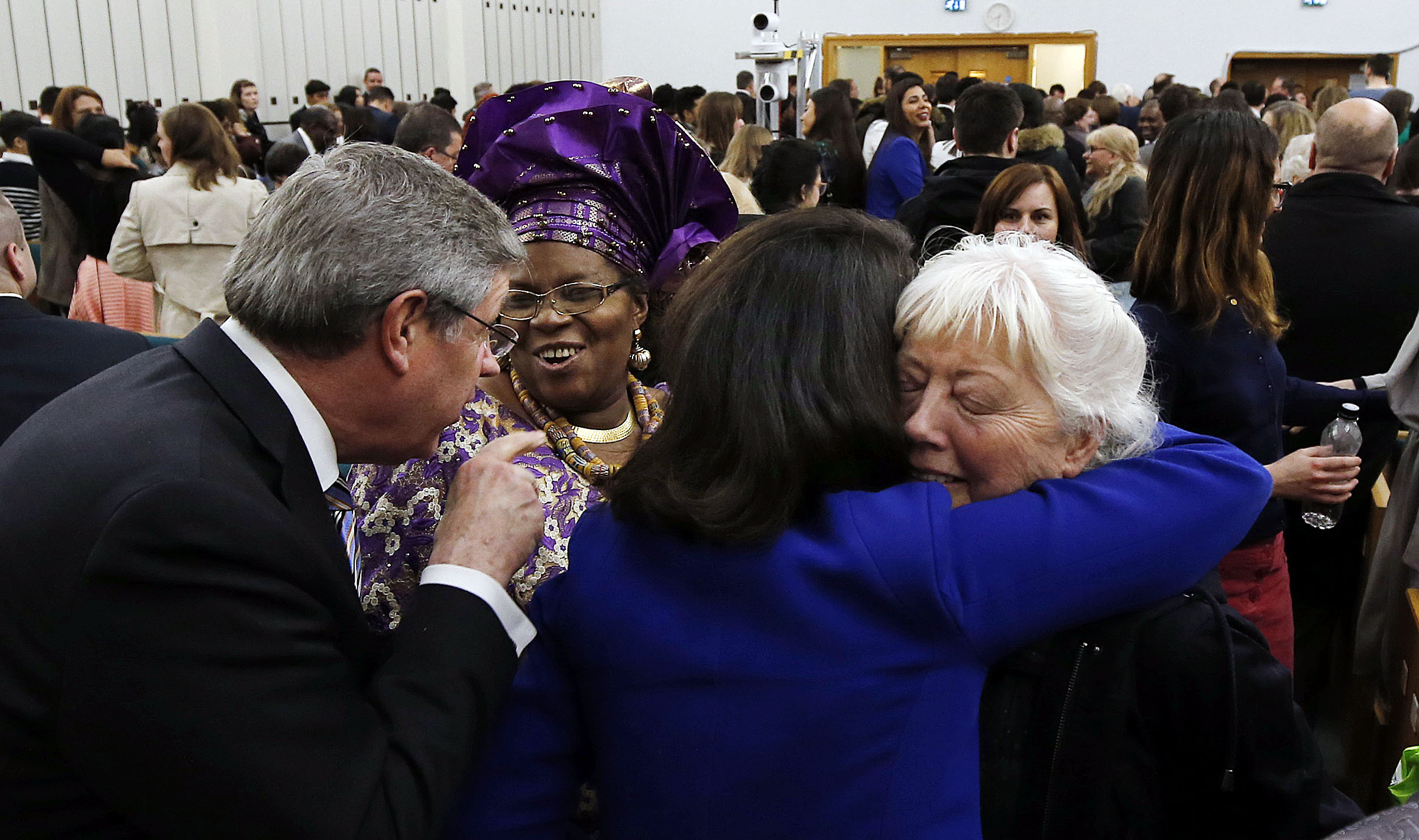 Sheila Bravin, right, hugs Sister Jean Stevens following a meeting at the Hyde Park in London on Thursday, April 12, 2018. At left, President Mark Stevens smiles with Caroline Yorke.