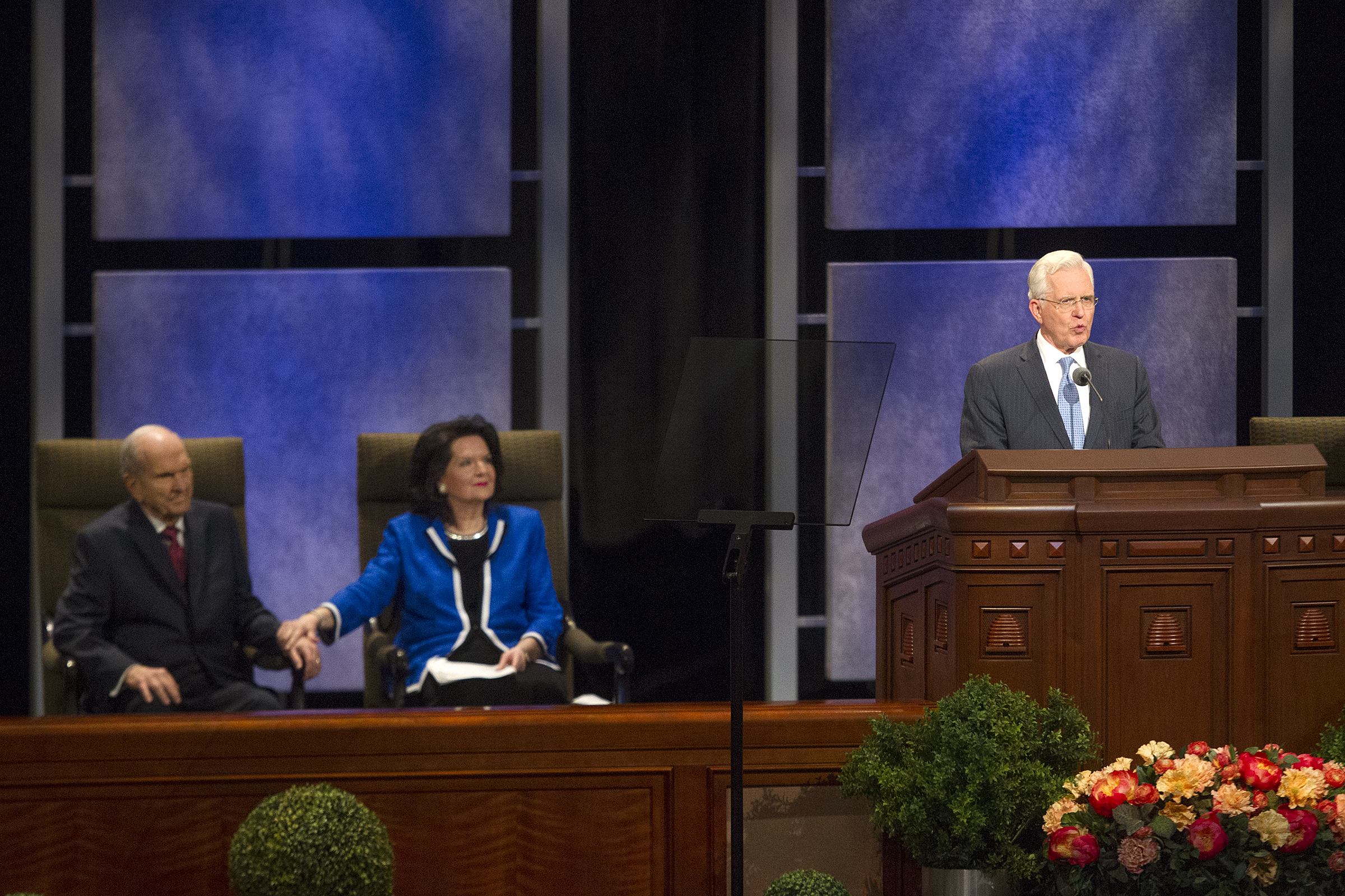 Elder D. Todd Christofferson of the Quorum of the Twelve Apostles of The Church of Jesus Christ of Latter-day Saints speaks as President Russell M. Nelson sits with his wife, Sister Wendy Nelson, during the Worldwide Youth Devotional at the Conference Center in Salt Lake City on Sunday, June 3, 2018.