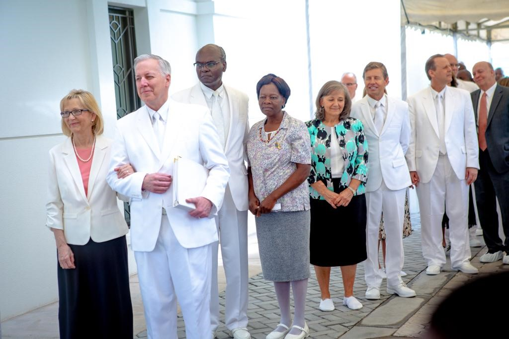 Elder Kevin S. Hamilton of the Seventy, with his wife, Sister Claudia Hamilton, participate in the cornerstone ceremony of the Kinshasa DR Congo Temple, along with the members of the Africa Southeast Area Presidency — Elder Joseph W. Sitati, Elder S. Mark Palmer, Elder Joni L. Koch — and their wives.