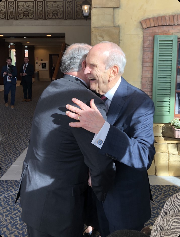Elder Ronald A. Rasband receives a hug from President Russell M. Nelson on March 9, 2019, in Rome, Italy.