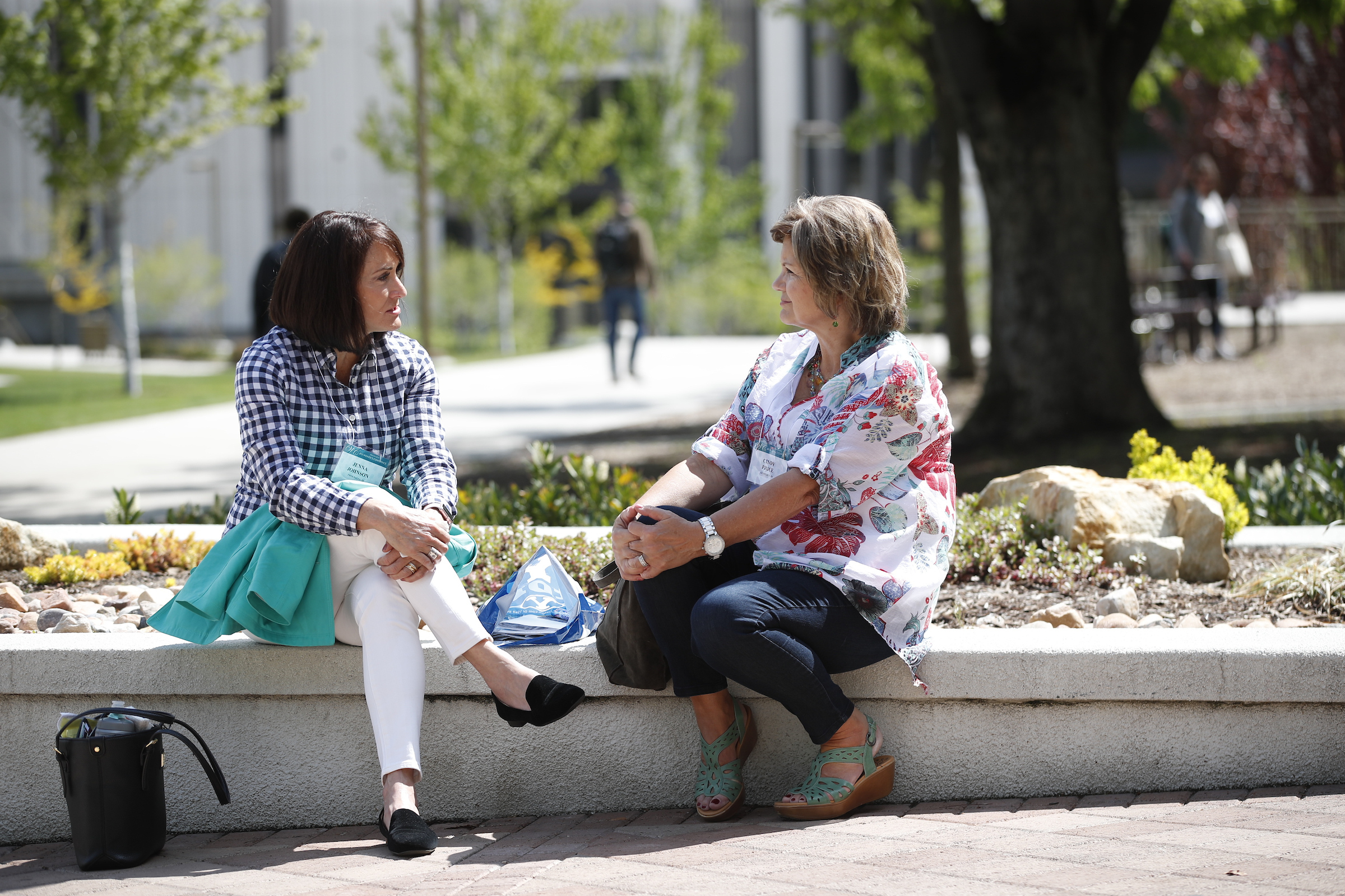 Women sit on the BYU campus during BYU Women's Conference on May 3.