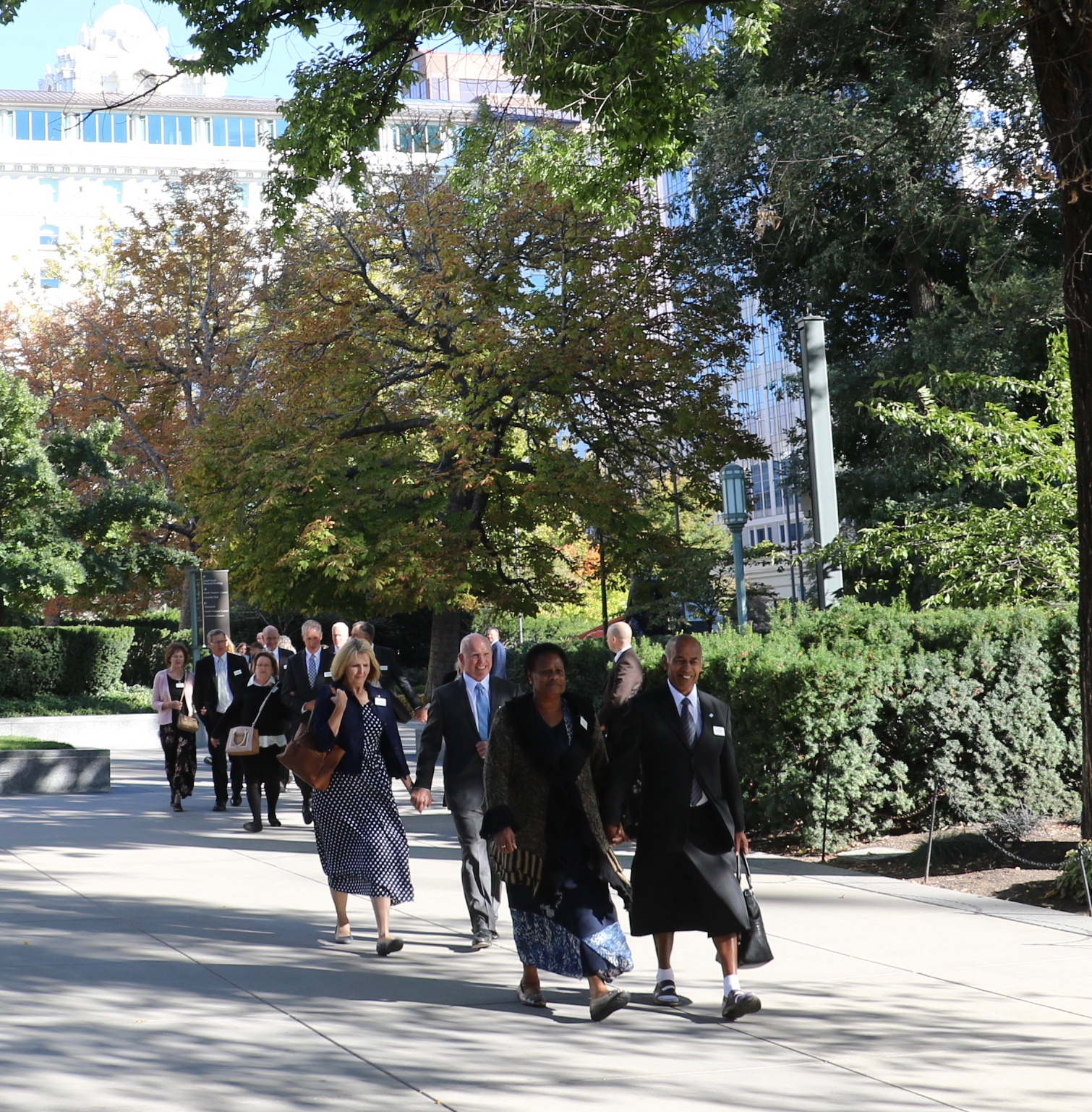 Couples attending the 2018 Seminar for New Temple Presidents and Matrons walk through Temple Square between seminar instruction inside the Salt Lake Temple and a photo session at the Salt Lake Tabernacle.