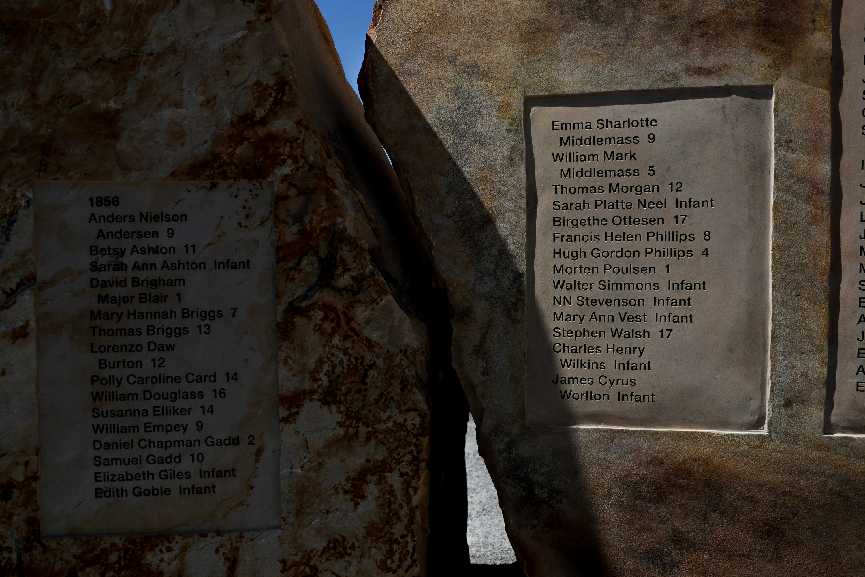 Stones list the names of pioneer children who died on the journey to the Salt Lake Valley at the Children's Pioneer Memorial at This Is the Place Heritage Park in Salt Lake City on the day of the memorial's dedication, Saturday, July 20, 2019.