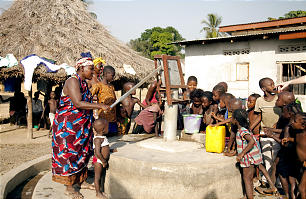 Villagers in rural Sierra Leone congregate at the well before sunrise and again before sunset. Each well provides clean water for an average of 800 to 900 people.
