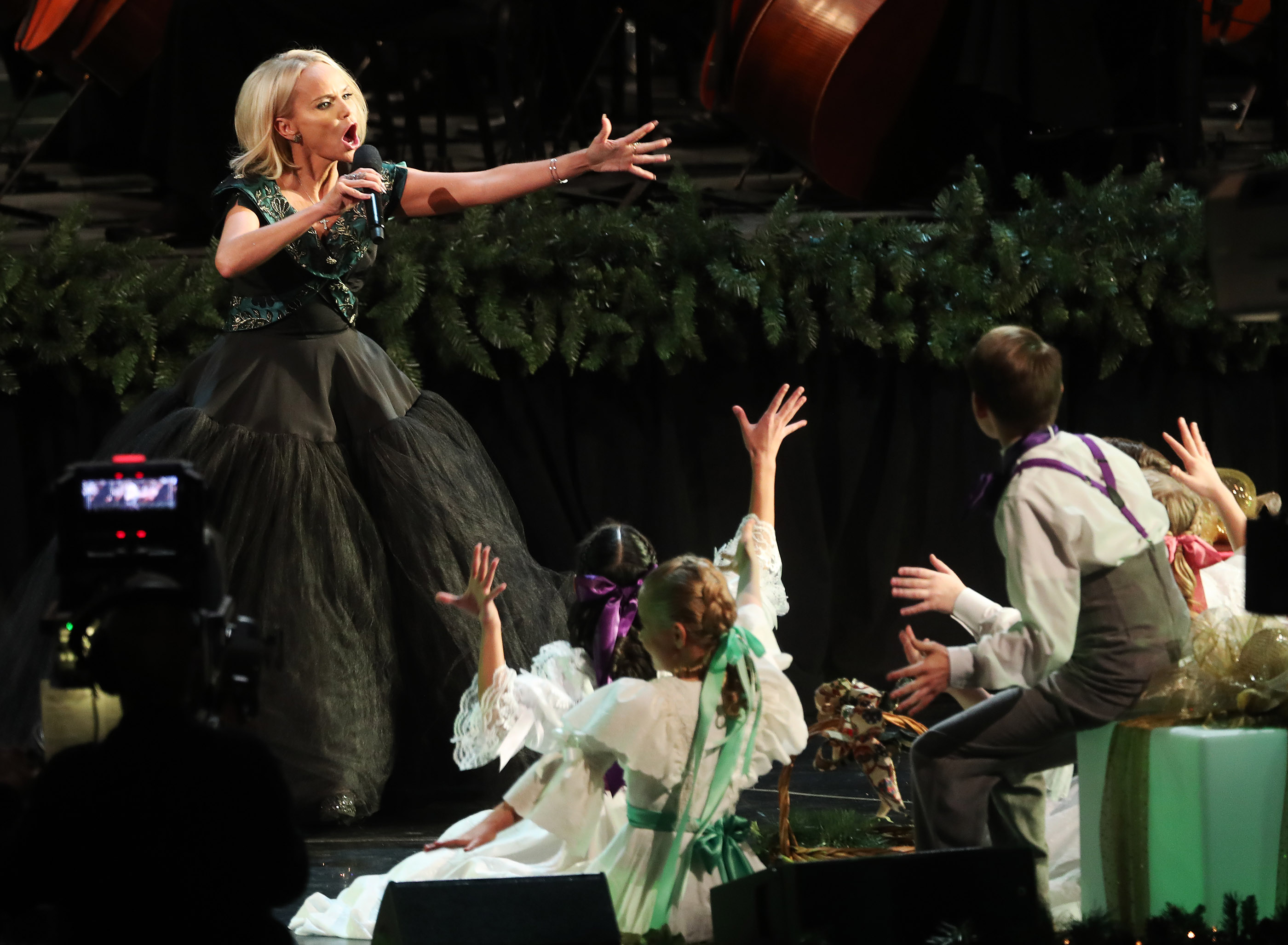Kristin Chenoweth sings with the Tabernacle Choir at Temple Square during their opening Christmas concert at the Conference Center in Salt Lake City on Thursday, Dec. 13, 2018.