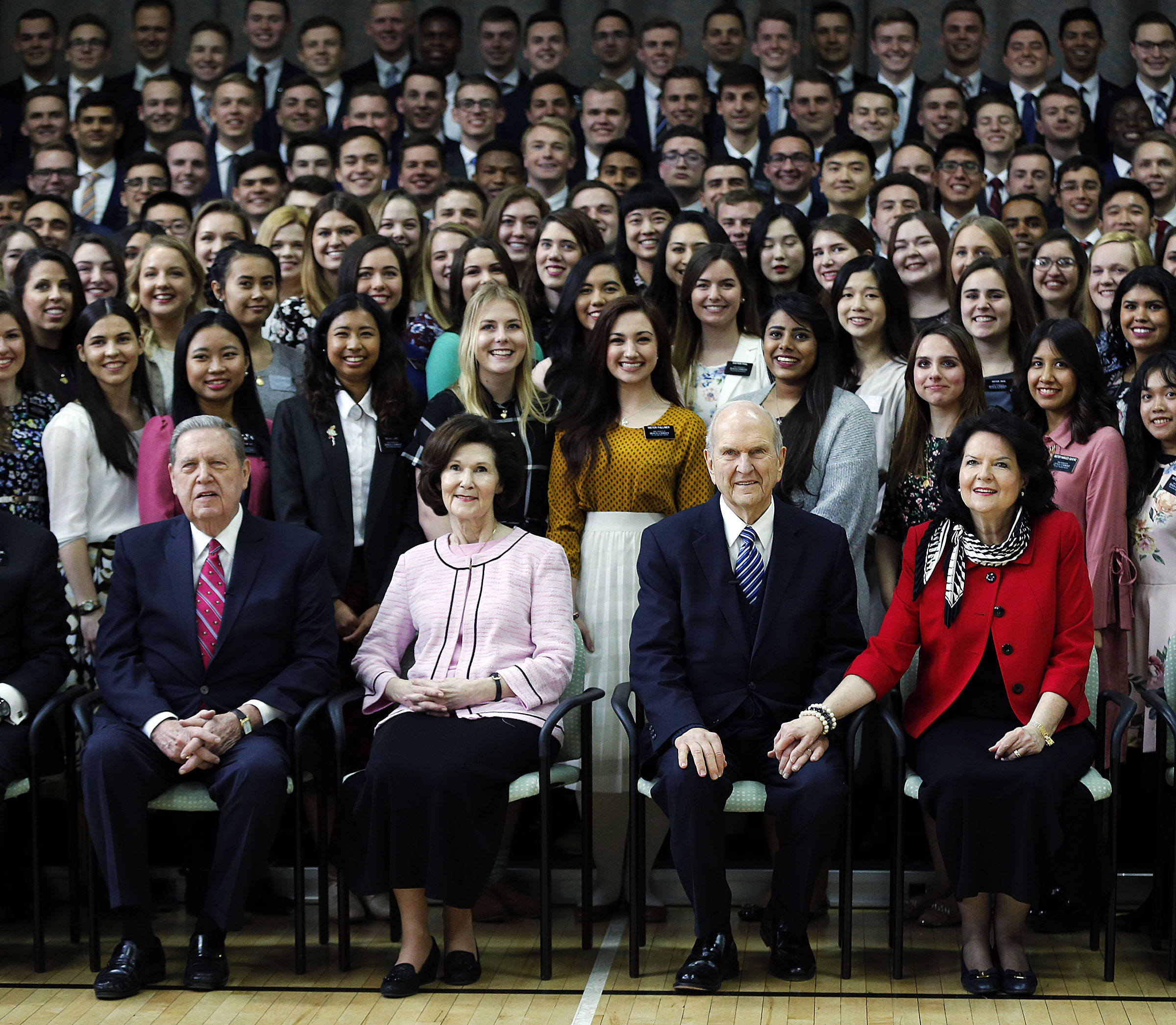 Elder Jeffrey R. Holland, left, Sister Patricia Holland, President Russell M. Nelson and Sister Wendy Nelson pose for a photo with missionaries at the Hyde Park Chapel in London on Thursday, April 12, 2018.