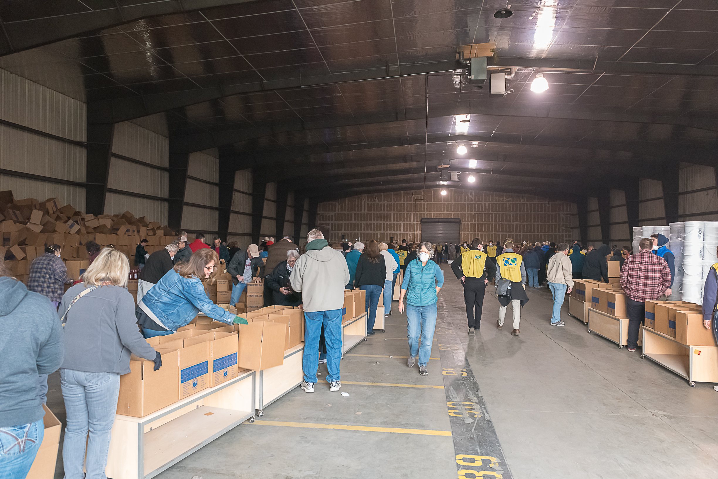 Several hundred Latter-day Saints and community members gather at a warehouse in Oroville, California, on Nov. 17, 2018, to package and distribute food and supplies to those impacted by a deadly wildfire that heavily damaged Paradise, California.