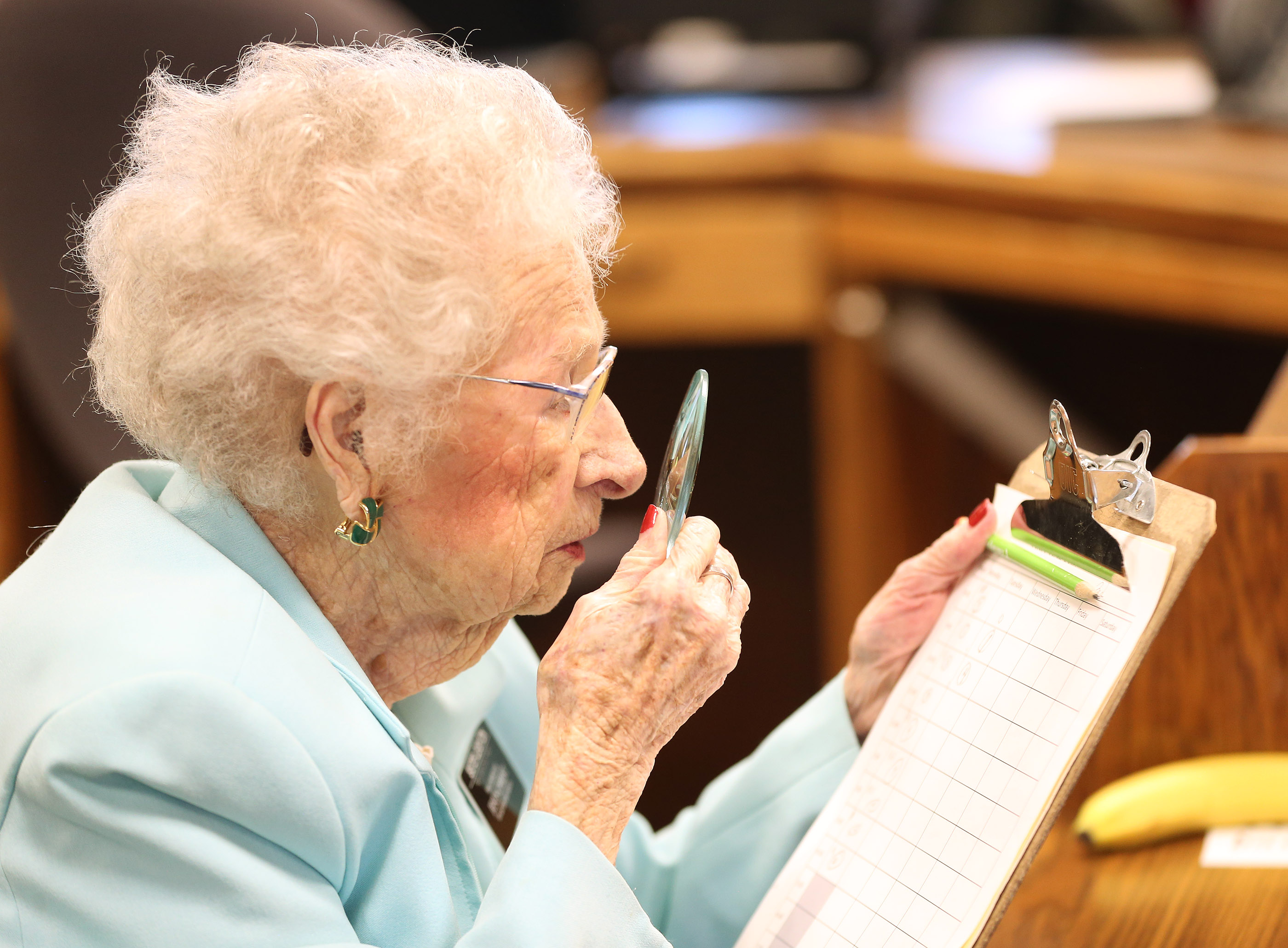 Nellie Leighton, 99, uses a magnifying glass for her missionary work at the Family History Library in Salt Lake City on Tuesday, Jan. 22, 2019. Leighton will celebrate her 100th birthday in February.