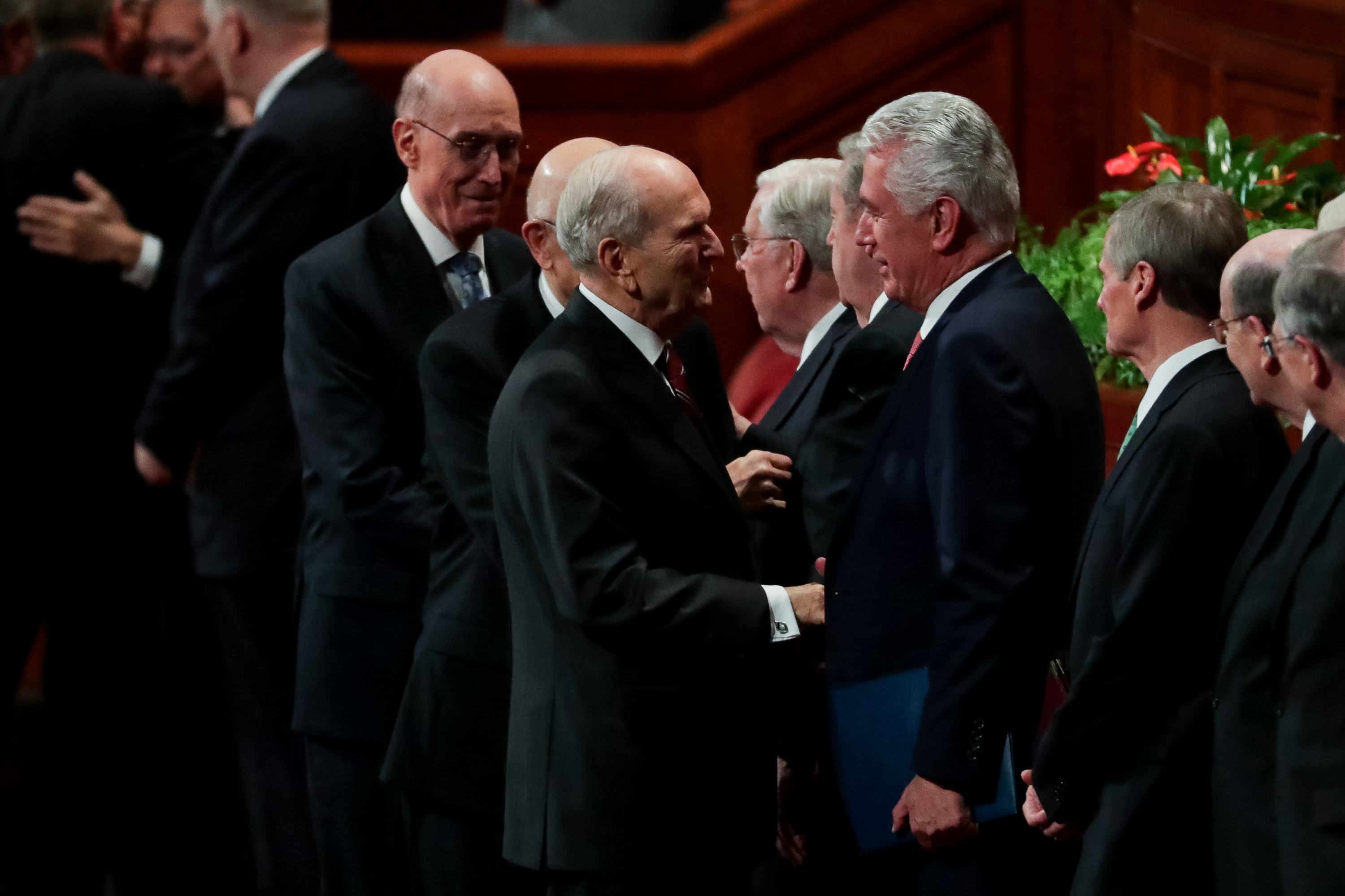 President Russell M. Nelson speaks to Elder Dieter F. Uchtdorf, of the Quorum of the Twelve Apostles, at the end of the Saturday afternoon session of the 188th Semiannual General Conference of The Church of Jesus Christ of Latter-day Saints in the Conference Center in Salt Lake City on Saturday, Oct. 6, 2018.