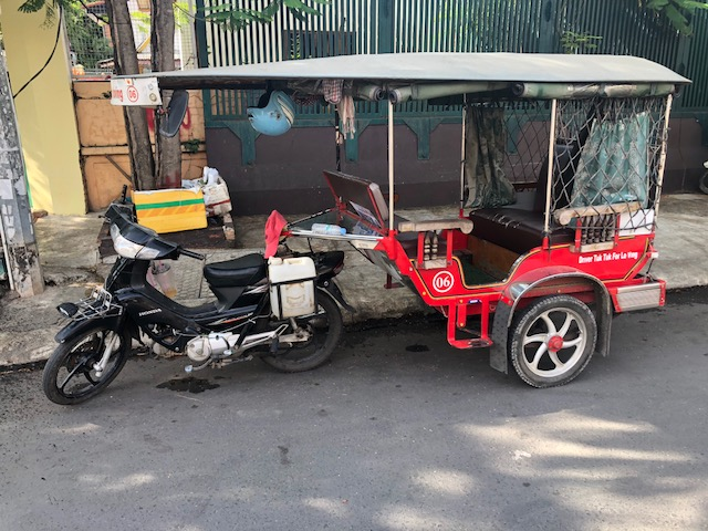 A typical Tuk Tuk parked near the mission home in Phnom Penh. Cambodians often use these modified motos to transport goods and people around the cities and countryside.