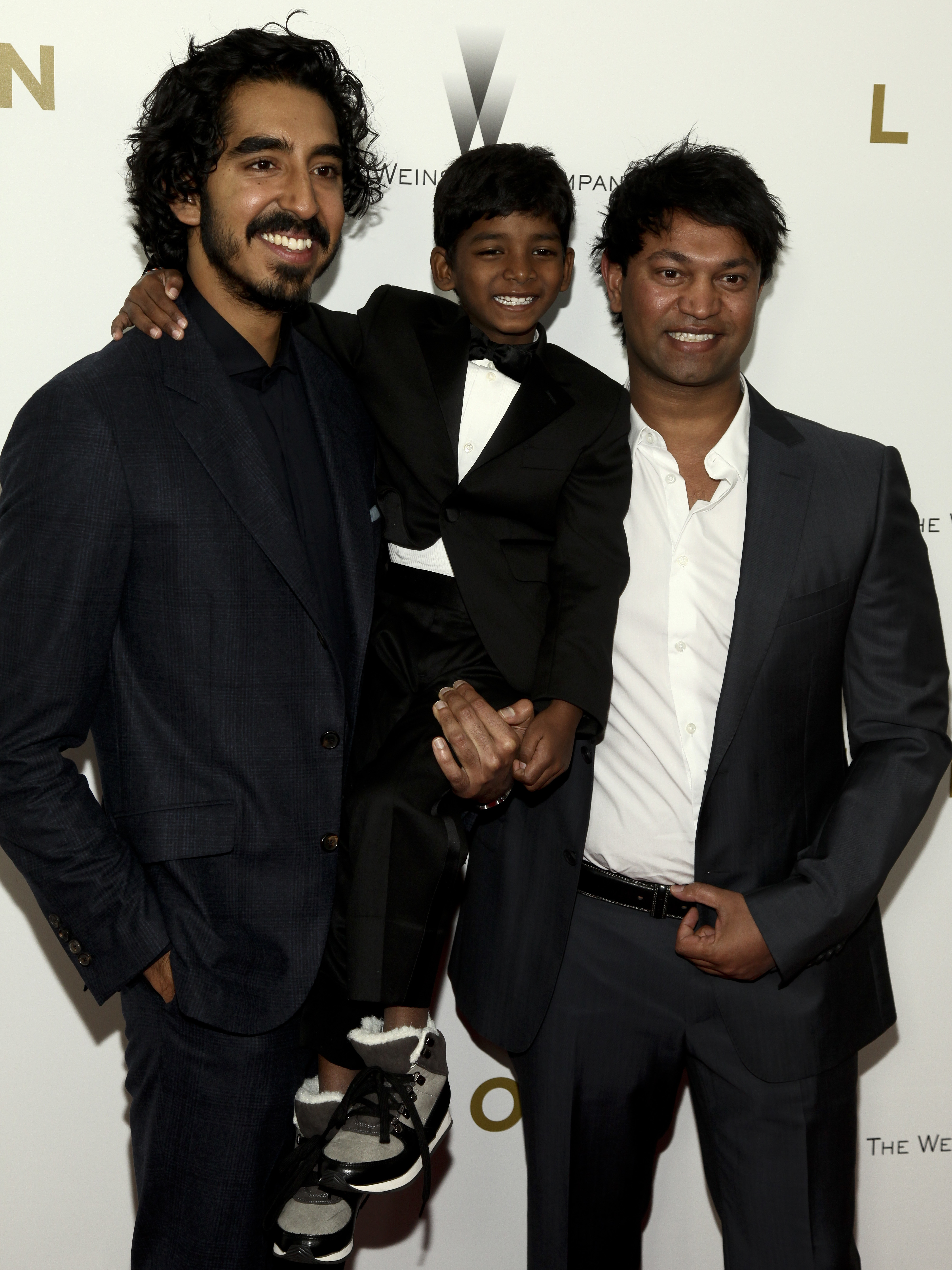 """Dev Patel, from left, Sunny Pawar and Saroo Brierley attend the premiere of """"Lion"""" at the Museum of Modern Art on Wednesday, Nov. 16, 2016, in New York. Brierley will appear at this year's RootsTech, scheduled for Feb. 27-March 2 at the Salt Palace Convention Center."""
