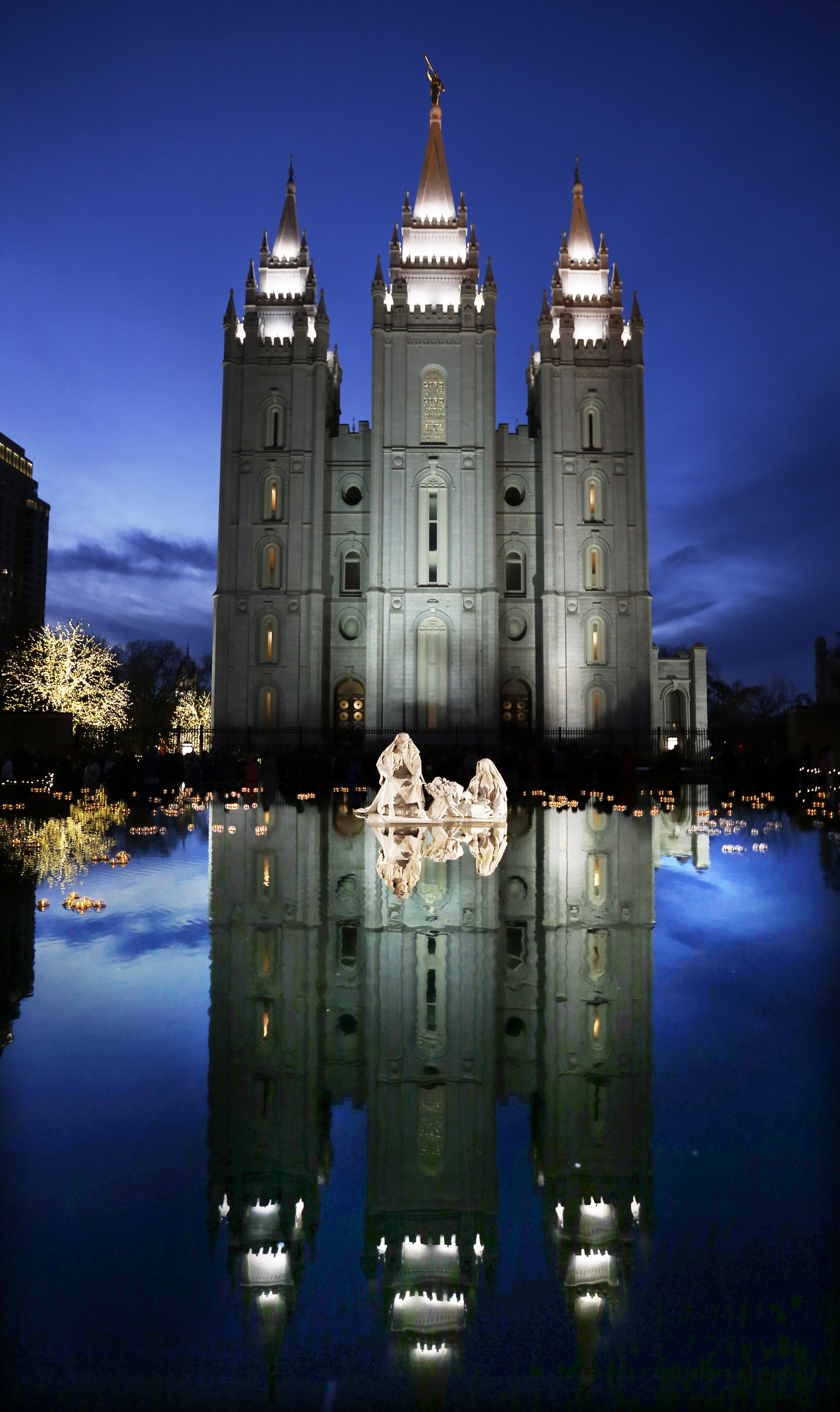 The Salt Lake Temple reflection is seen in the Main Street Plaza reflection pond in Salt Lake City on Friday, Nov. 24, 2017.