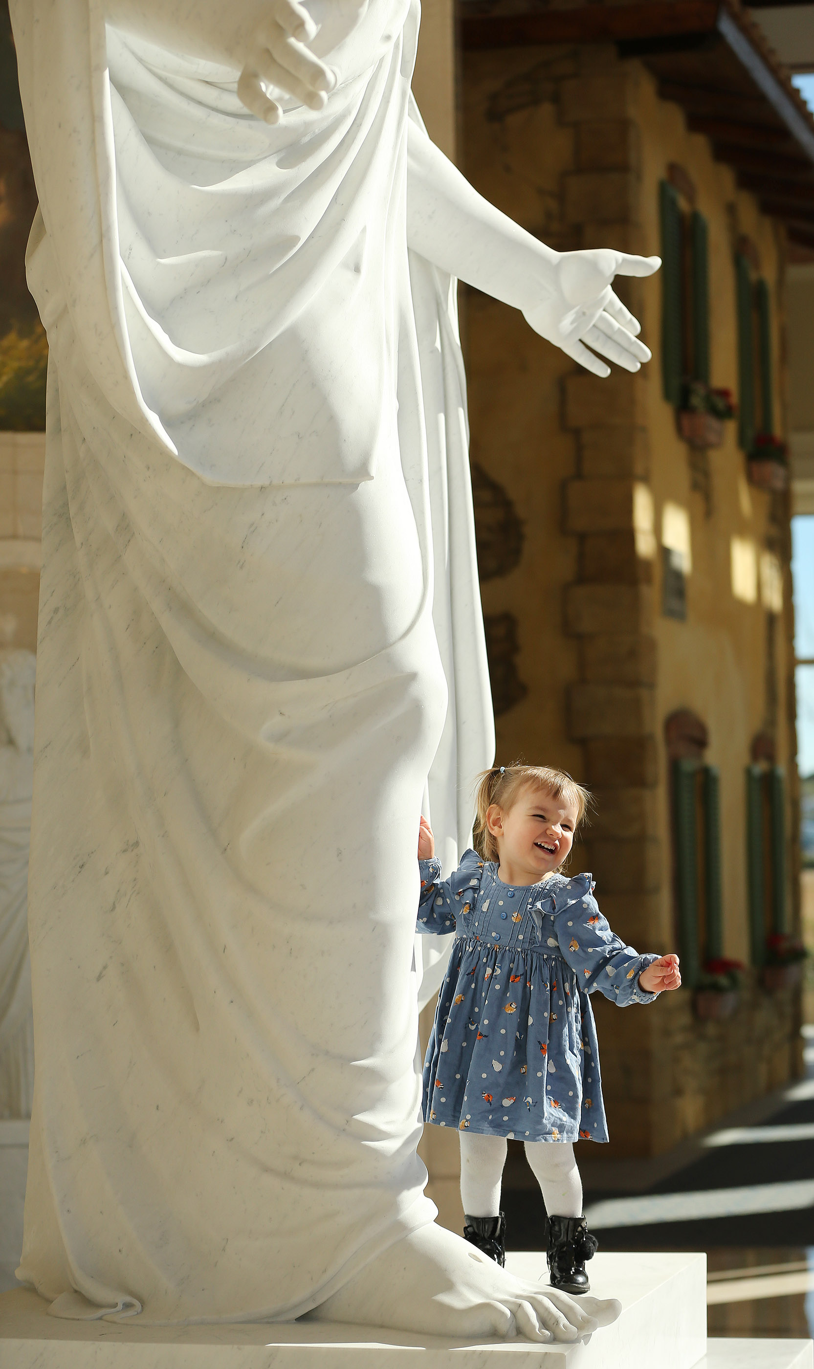 Arianna Giovita stands by the Christus statue in the Rome Italy Temple Visitors' Center in Rome on Tuesday, March 12, 2019.