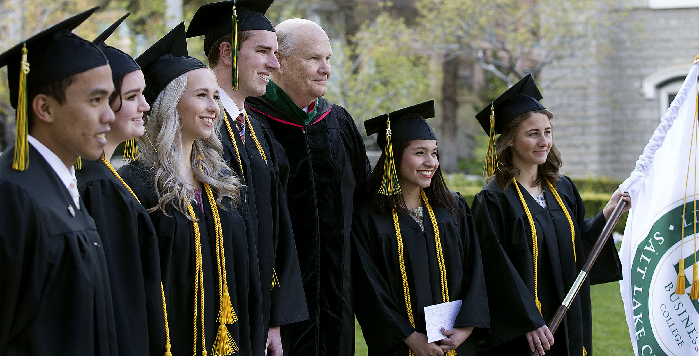Elder Dale G. Renlund is photographed with students before the LDS Business College graduation at Temple Square in Salt Lake City on Friday, April 13, 2018.