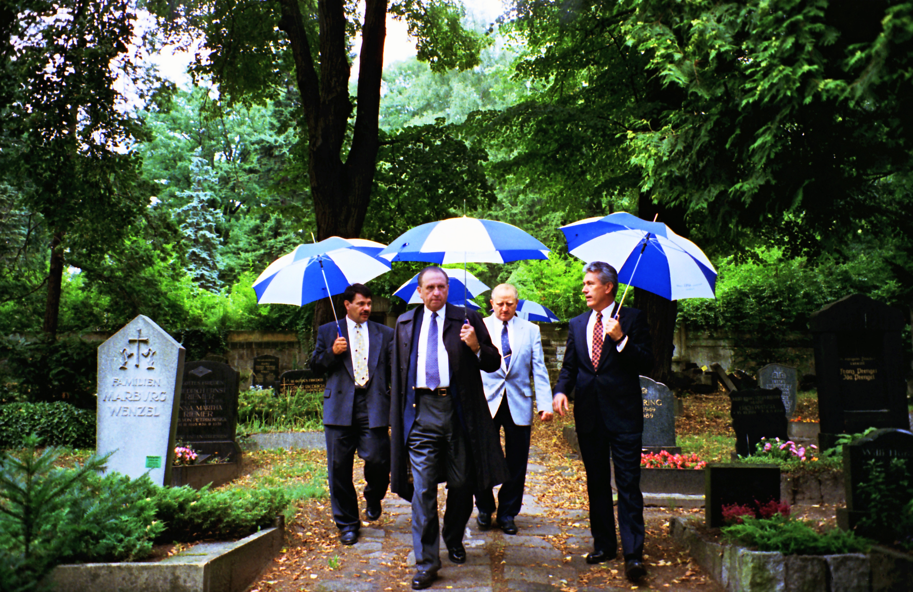 President Thomas S. Monson, front left, and Elder Dieter F. Uchtforf, at right, Siegfried Sacher and Frank Apel walk toward the grave of Elder Joseph A. Ott in Dresden, Germany, Aug. 26, 1995.
