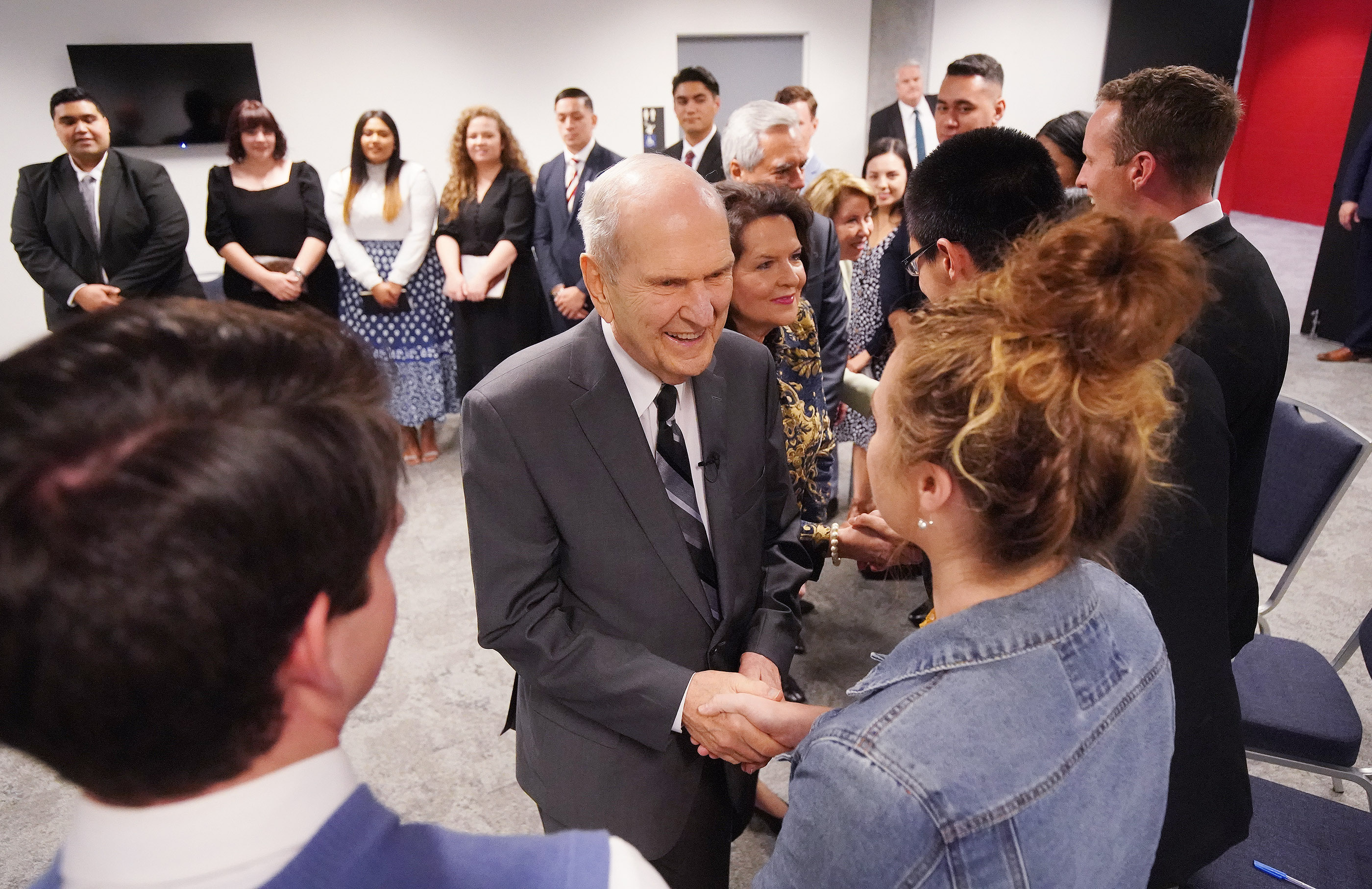 President Russell M. Nelson of The Church of Jesus Christ of Latter-day Saints and his wife, Sister Wendy Nelson, meet with youth during a meeting on May 19, 2019, in Sydney, Australia.