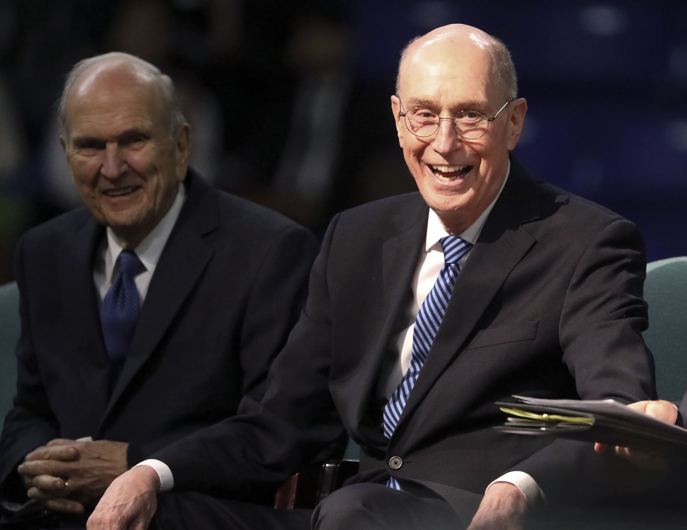 President Henry B. Eyring, second counselor in the First Presidency, laughs while sitting with President Russell M. Nelson of The Church of Jesus Christ of Latter-day Saints at the Langley Events Center in Langley, British Columbia, on Sunday, Sept. 16, 2018.