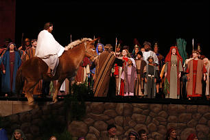 Actor portraying Christ during the triumphal entry scene.