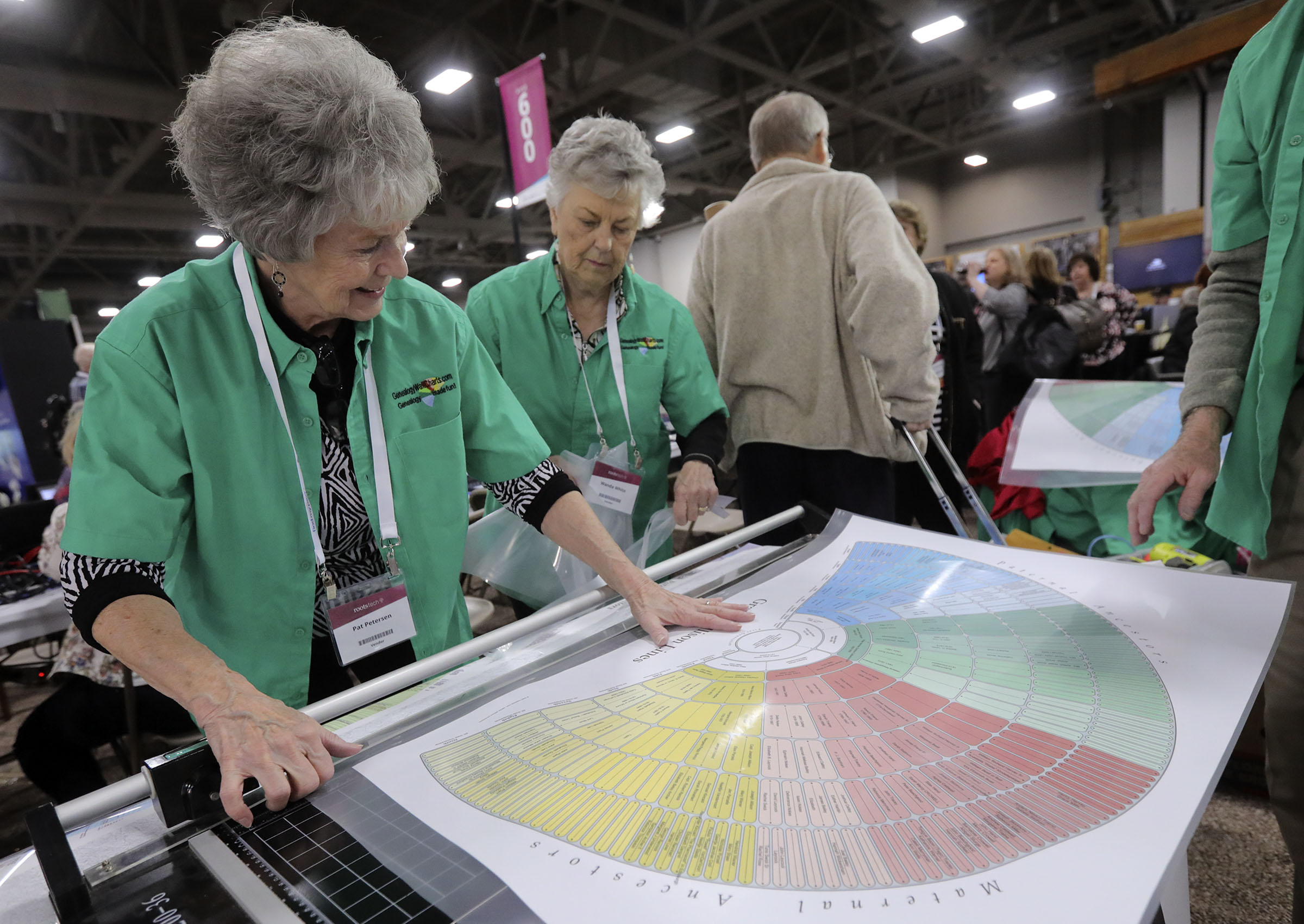 Pat Petersen trims a laminated genealogy chart at Genealogy WallCharts at RootsTech at the Salt Palace Convention Center in Salt Lake City on Thursday, Feb. 28, 2019.