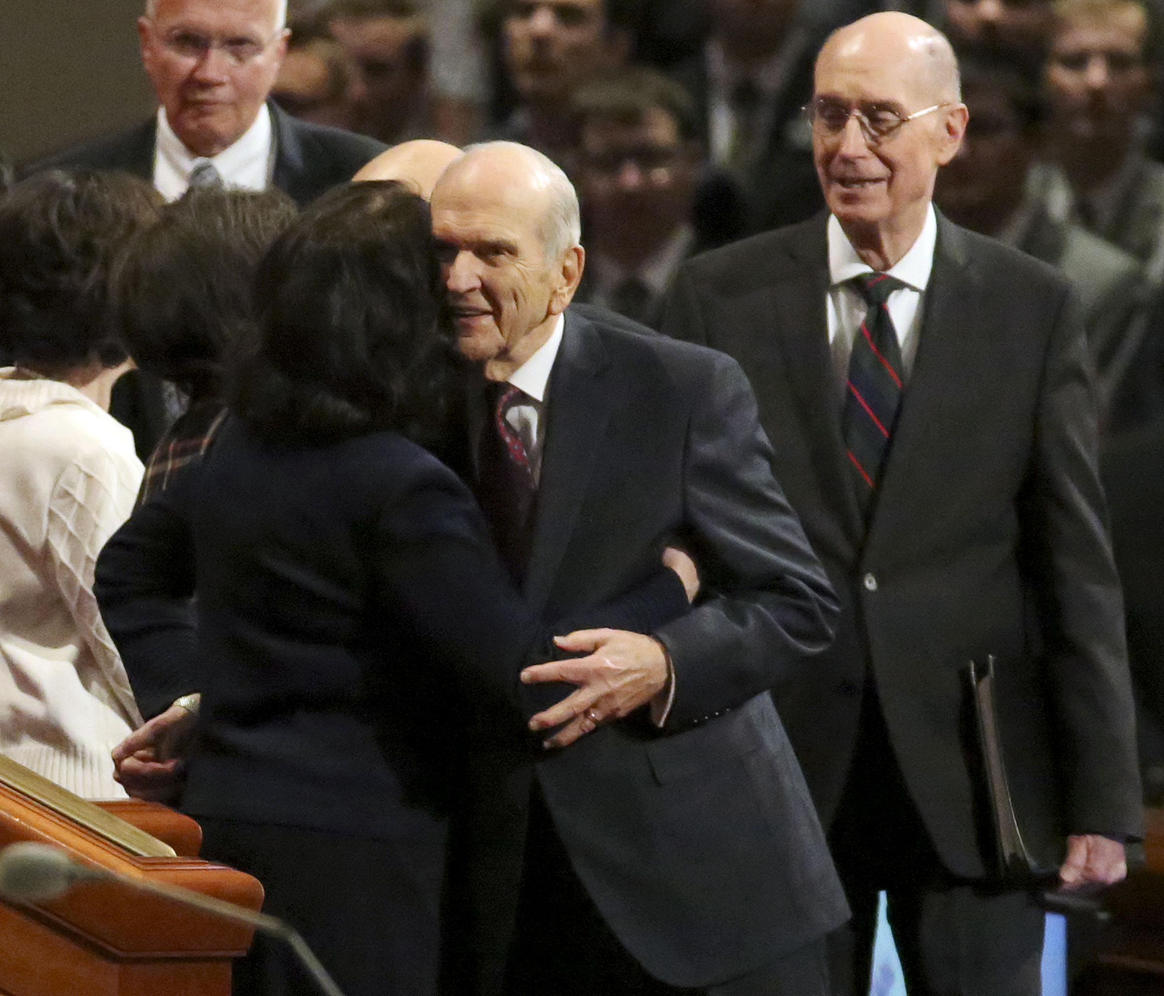 President Russell M. Nelson hugs his wife, Sister Wendy Nelson, as he enters the Sunday afternoon session of the 188th Semiannual General Conference of The Church of Jesus Christ of Latter-day Saints in the Conference Center in downtown Salt Lake City on Sunday, Oct. 7, 2018.