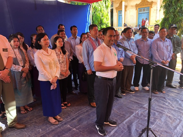 Bishop Samnang Sea who works as a Church Service Center manager in Cambodia, spoke to the group in Maha Leap as they received food donations from LDS Charities in late September.
