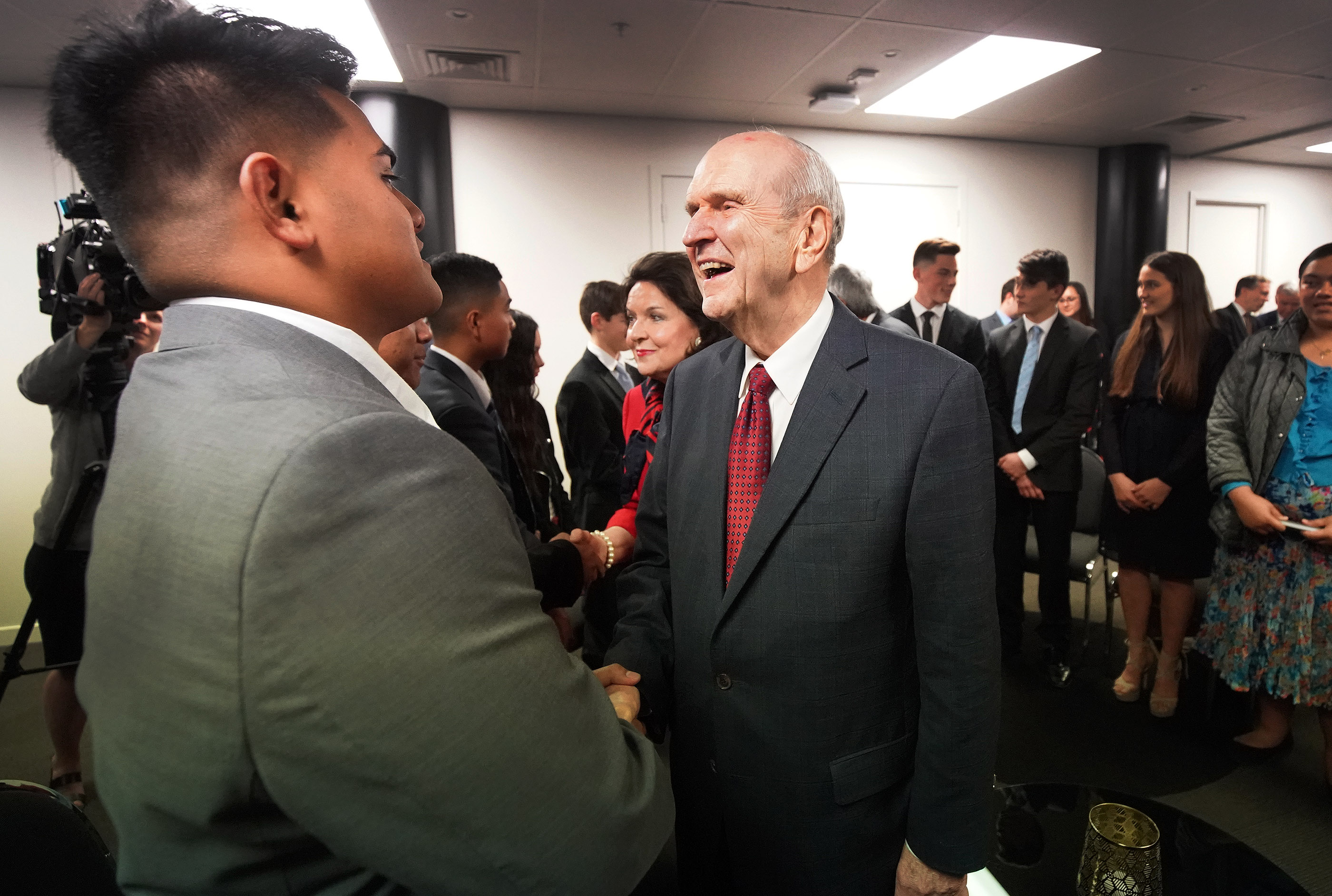 President Russell M. Nelson of The Church of Jesus Christ of Latter-day Saints meets Lorenzo Tagiloa in a youth meeting in Auckland, New Zealand, on May 21, 2019.
