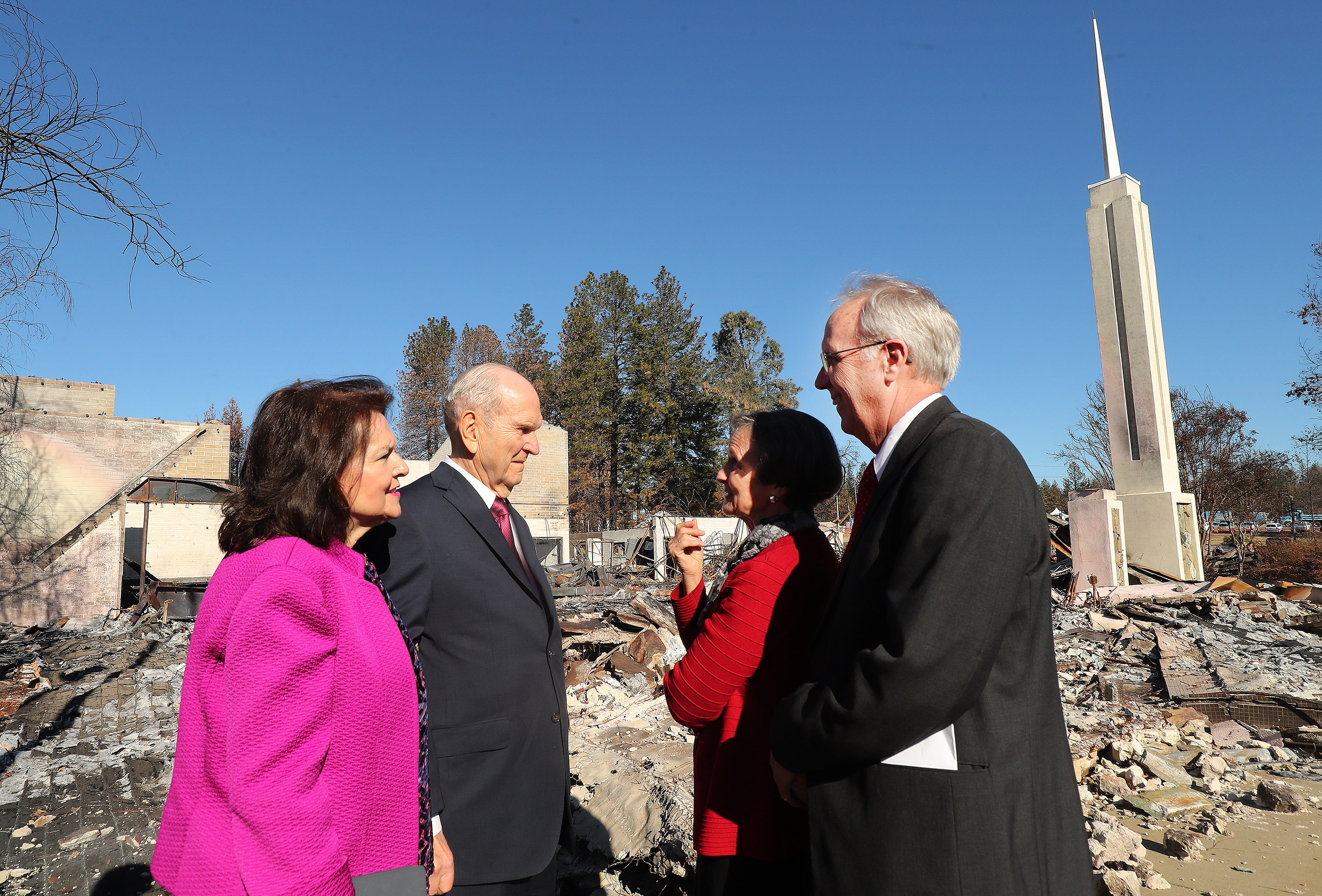 "President Russell M. Nelson of The Church of Jesus Christ of Latter-day Saints and his wife Wendy Nelson talk with fire victims Rick and KathieTurner by the burned LDS Chapel in Paradise, California on Sunday, Jan. 13, 2019, two months after the Camp Fire destroyed 1,400 homes and hundreds of businesses. President Nelson wrote about the visit in an op-ed published Feb. 10 in The Arizona Republic. Life with God is far better than one without him, he wrote in the op-ed, titled ""Healing Hearts."""
