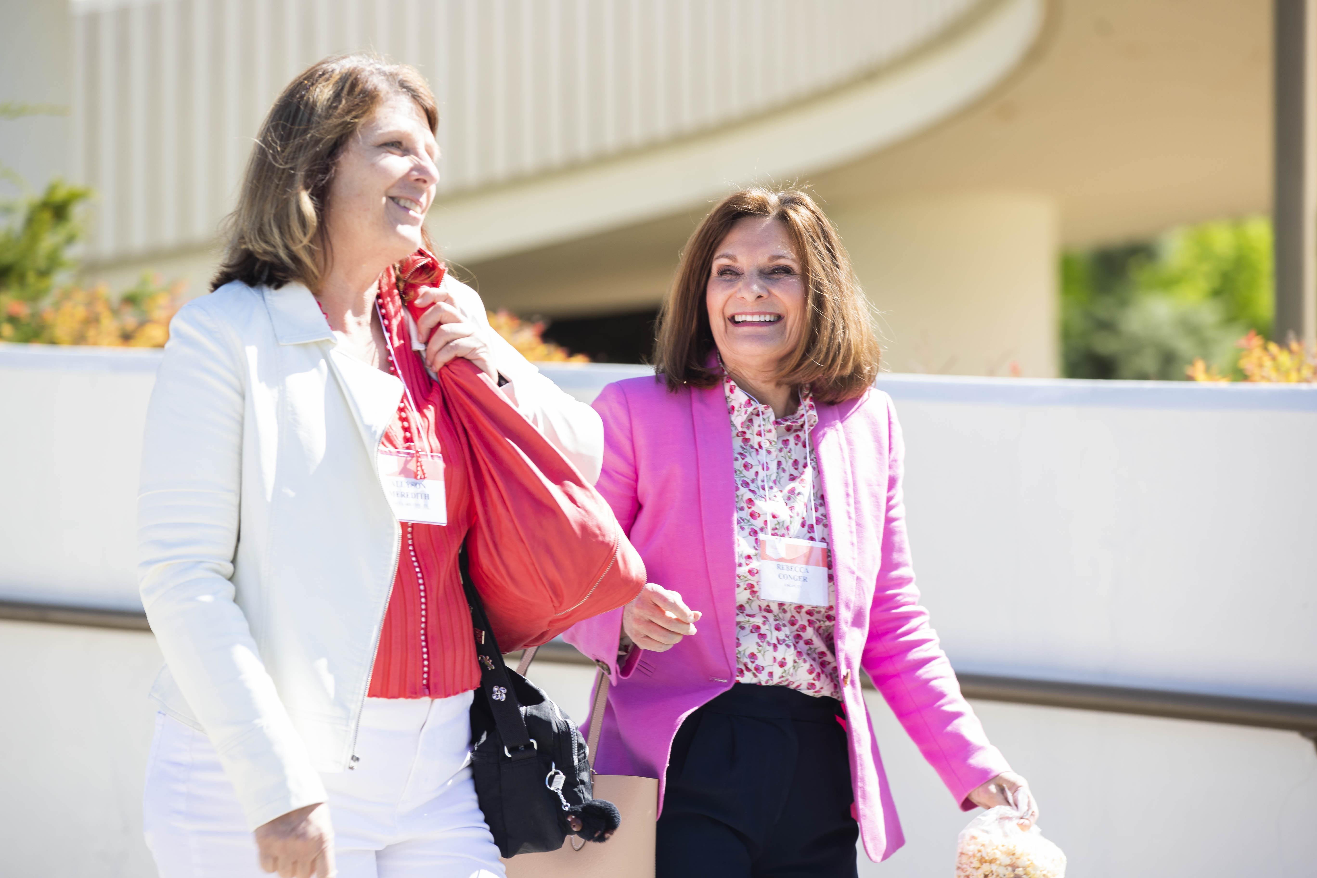 Two women exit the Marriott Center as they head to classes for the 2019 BYU Women's Conference on May 2.