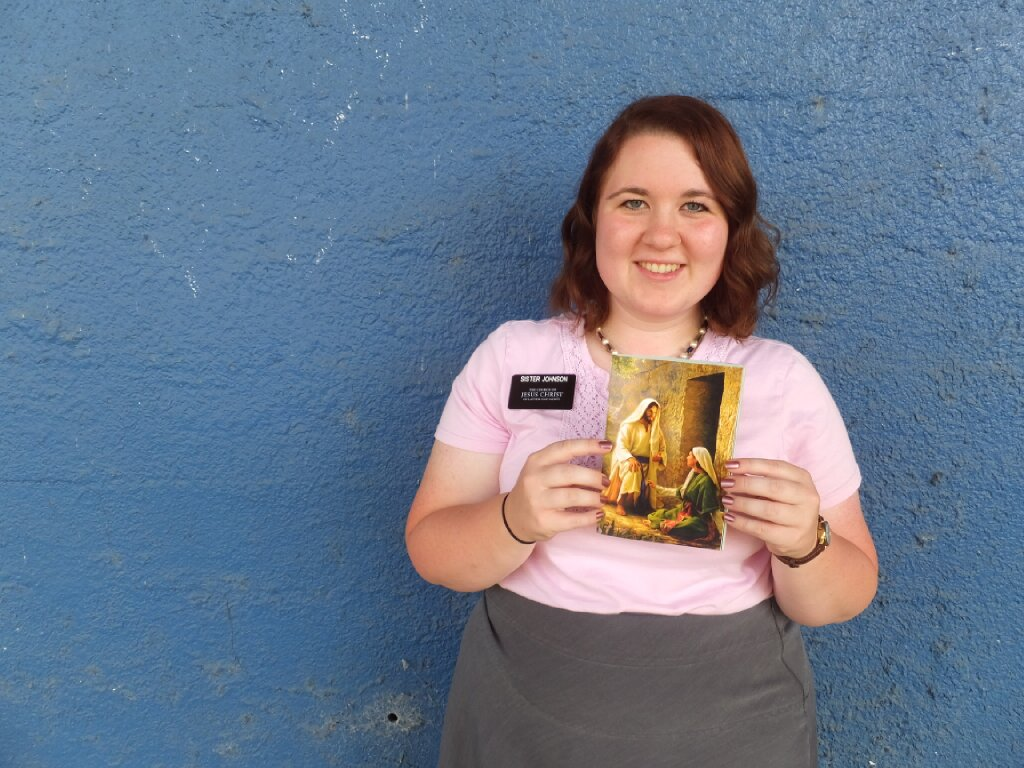 Sister Valerie Johnson, a missionary in the Florida Jacksonville Mission from March 2013-September 2014, poses for a photo with a pamphlet in Waycross, Georgia.