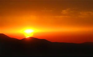 Caption Only Photo. The sun sets below Lake Mountain, West of Utah Lake, turning a part of the sky orange. Nov. 25, 2003. Photo by Stuart Johnson (Submission date: 11/25/2003) (Submission date: 03/07/2005)