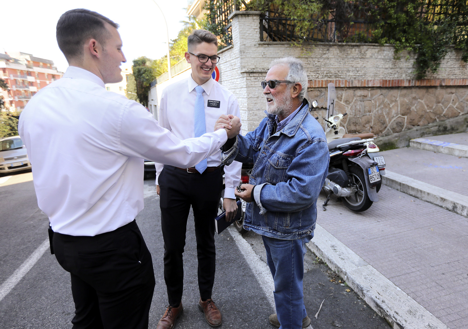 Elder Bryce Dickey and Elder Travis Wagstaff talk to a man as part of their finding efforts in Rome, Italy, on Saturday, Nov. 17, 2018.
