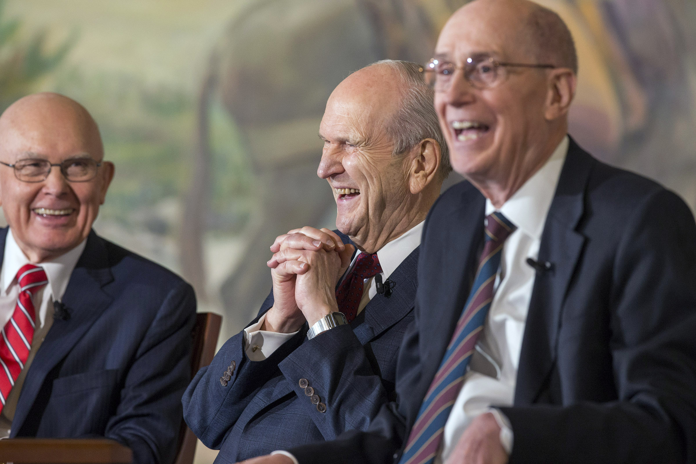 President Russell M. Nelson, the 17th President of The Church of Jesus Christ of Latter-day Saints, and his councilors President Dallin H. Oaks, first counselor, left, and President Henry B. Eyring, second counselor, right, share in a laugh at a press conference in Salt Lake City, Utah on Tuesday, Jan. 16, 2018.