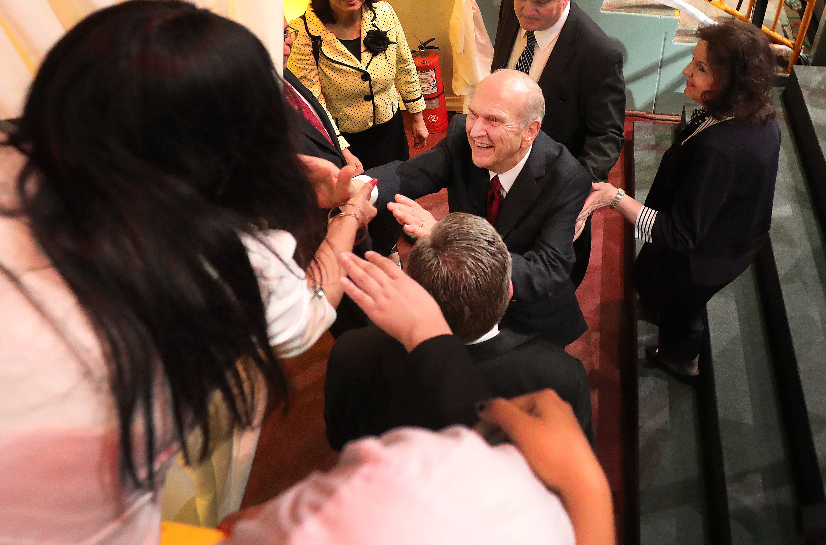 President Russell M. Nelson of The Church of Jesus Christ of Latter-day Saints and how wife Sister Wendy Nelson greet attendees after a devotional in Lima, Peru on Oct. 20, 2018.