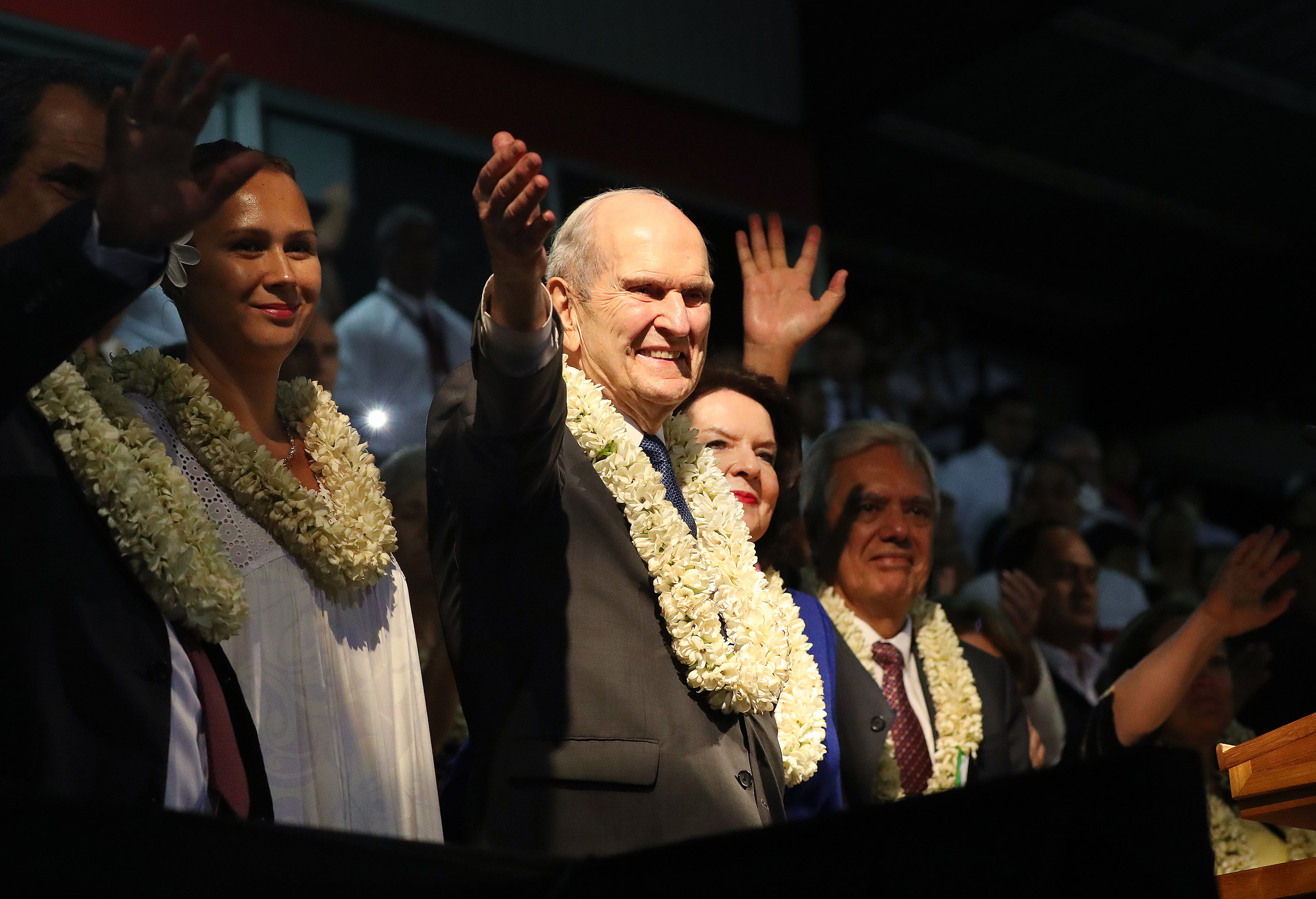 President Russell M. Nelson of The Church of Jesus Christ of Latter-day Saints and his wife, Sister Wendy Nelson, wave to attendees after a devotional in Papeete, Tahiti, on May 24, 2019.