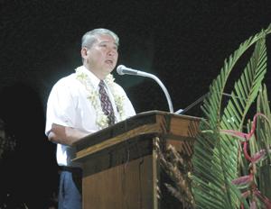 Elder Jean A. Tefan, Area Authority Seventy, addresses devotional.